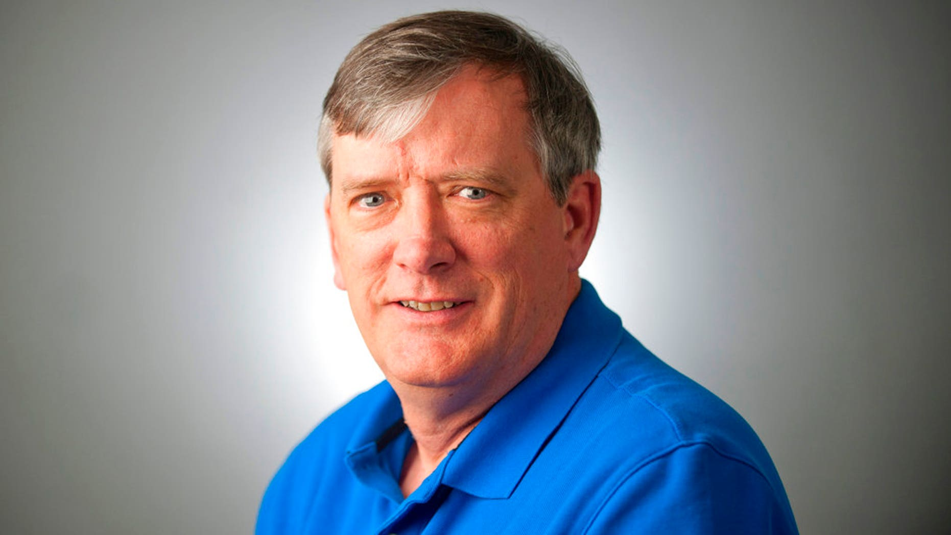 FILE - This undated file photo shows reporter John McNamara of the Capital Gazette, who was one of the victims when an active shooter targeted the newsroom, Thursday, June 28, 2018 in Annapolis, Md. The widow of the slain Maryland newspaper reporter, McNamara, has spread his ashes at Nationals Park. The Baltimore Sun reported that Andrea Chamblee placed the ashes of McNamara in a planter of begonias at the park Saturday, Sept. 1, 2018. (The Baltimore Sun via AP, File)