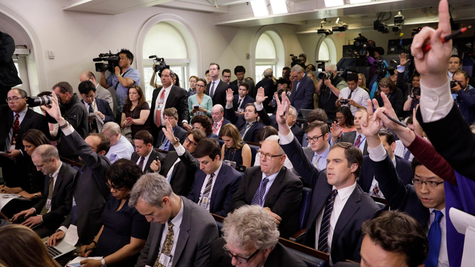 Reporters ask questions in the White House briefing room in Washington, April 26, 2017.