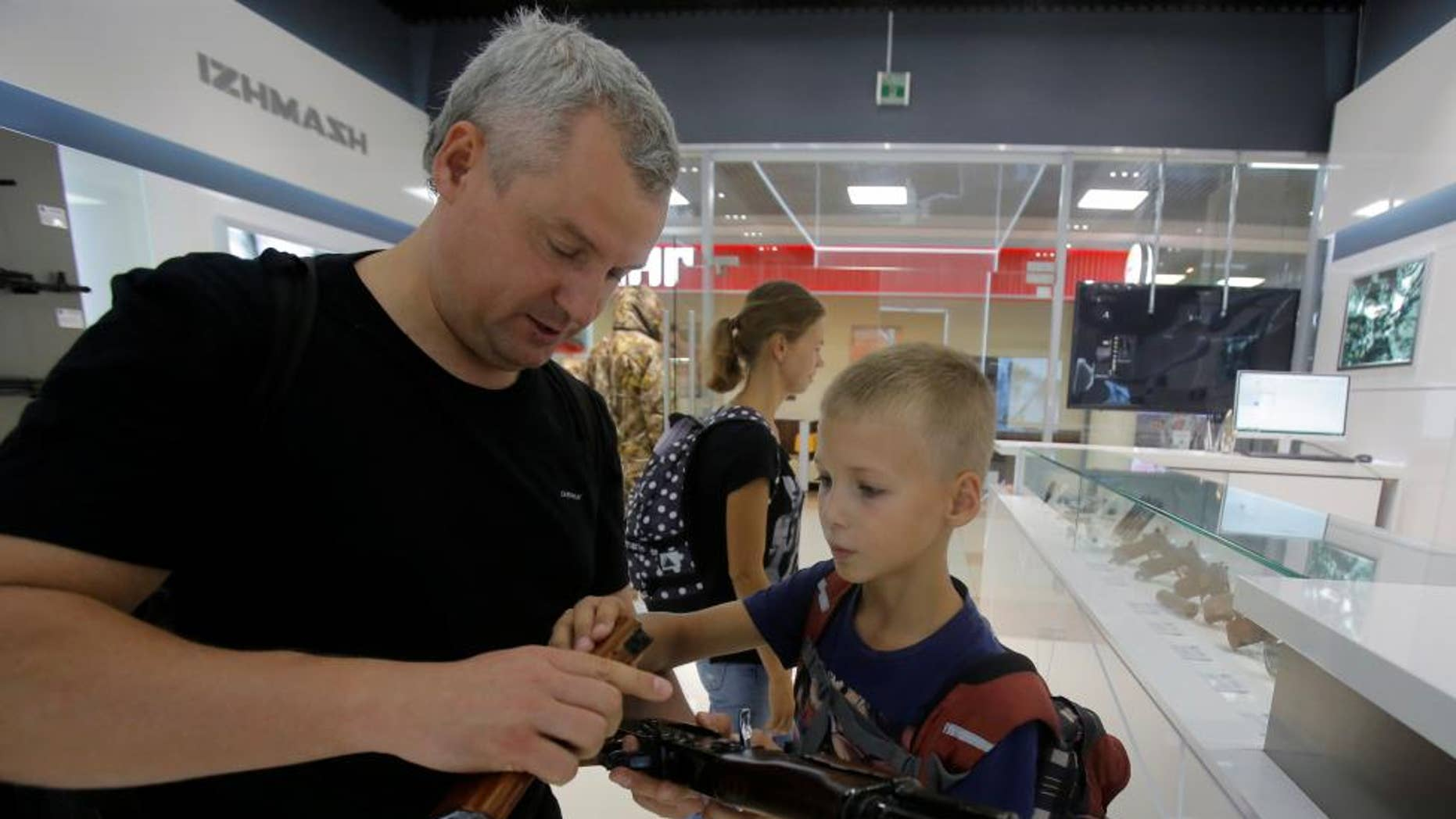 Kalashnikov, whose AK-47 assault rifle has armed Russian forces for 70 years and been the preferred weapon of insurgents across continents, has opened a store at Moscow's Sheremetyevo airport selling souvenirs including plastic model guns, the company said.