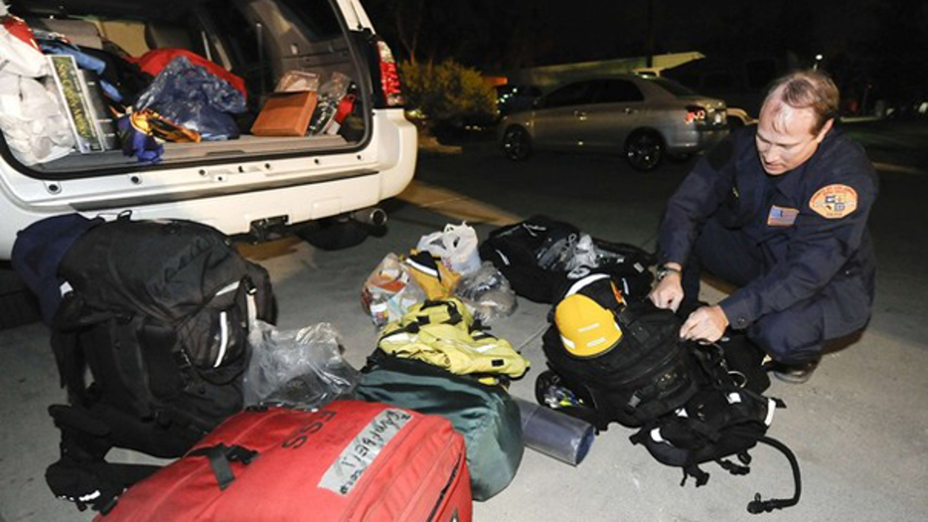 Los Angeles County Fire Department search-and-rescue technician Don Campbel prepares to depart for Haiti with his team Jan. 12. (Reuters Photo)