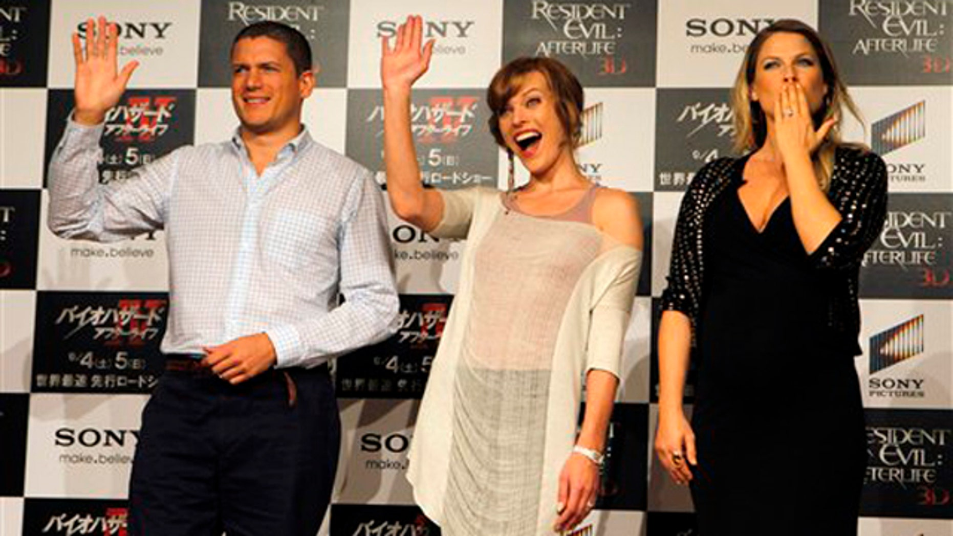 """Actresses Milla Jovovich, center, Ali Larter, right, and actor Wentworth Miller react during a press conference for their film """"Resident Evil: Afterlife"""" in Tokyo Friday, Sept. 3, 2010. (AP Photo/Junji Kurokawa)"""