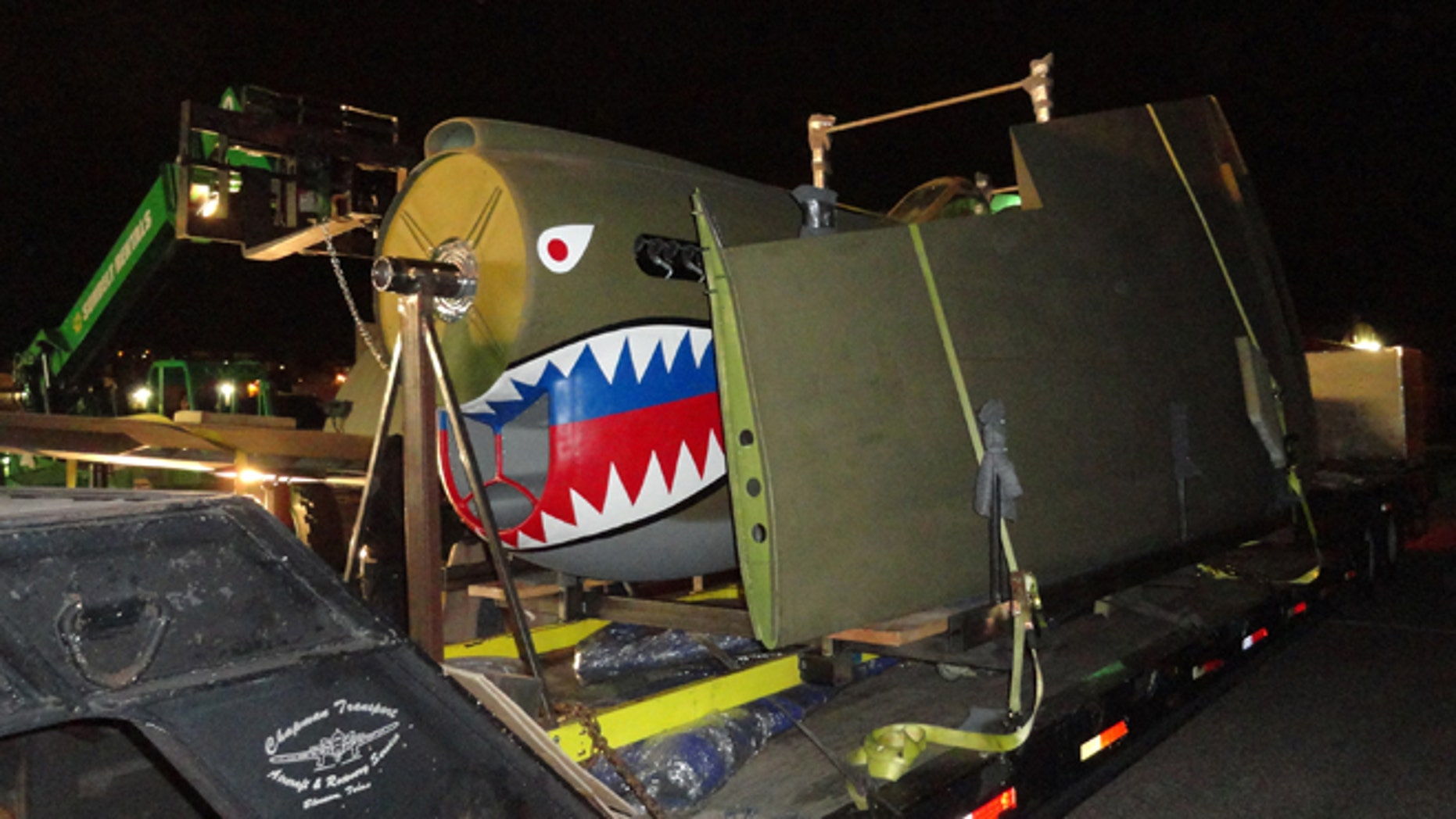 Jan. 21, 2014: In this photo made available by Rolando Gutierrez shows a Curtis P-40 Warhawk fighter plane as it is loaded for transport in San Diego, Calif. The warplane is bound for the World War II Museum in New Orleans, LA. The P-40E is the model flown by the 1st American Volunteer Group during World War II. It was immortalized in military lore in a John Wayne film.