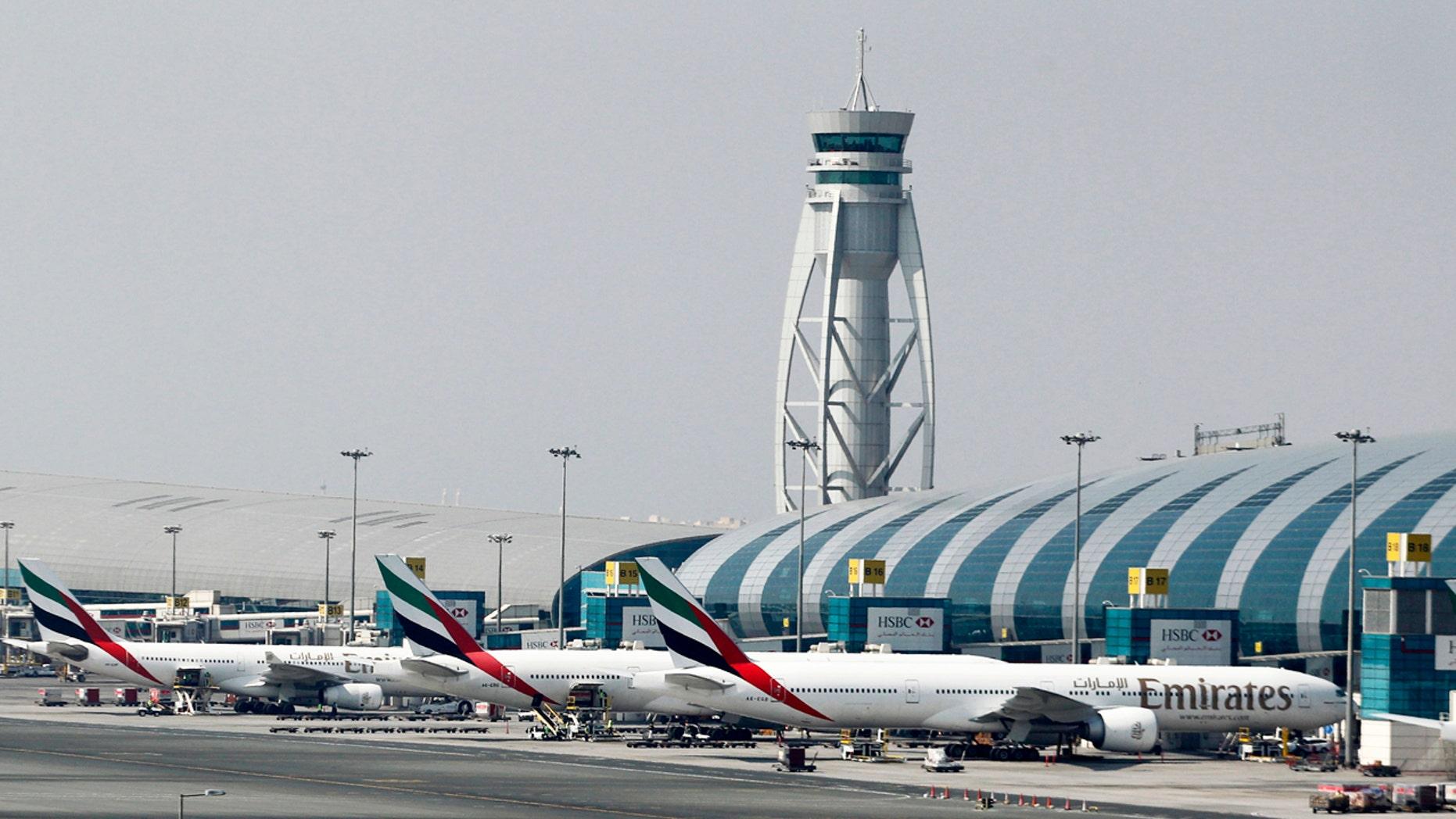 Emirates airplanes at Dubai International Airport.