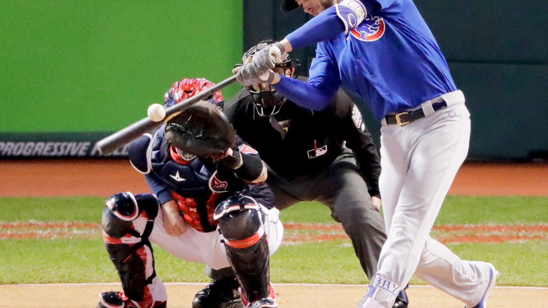 Chicago Cubs' Kris Bryant hits a single during the first inning of Game 2 of the Major League Baseball World Series against the Cleveland Indians Wednesday, Oct. 26, 2016, in Cleveland. (AP Photo/Charlie Riedel)