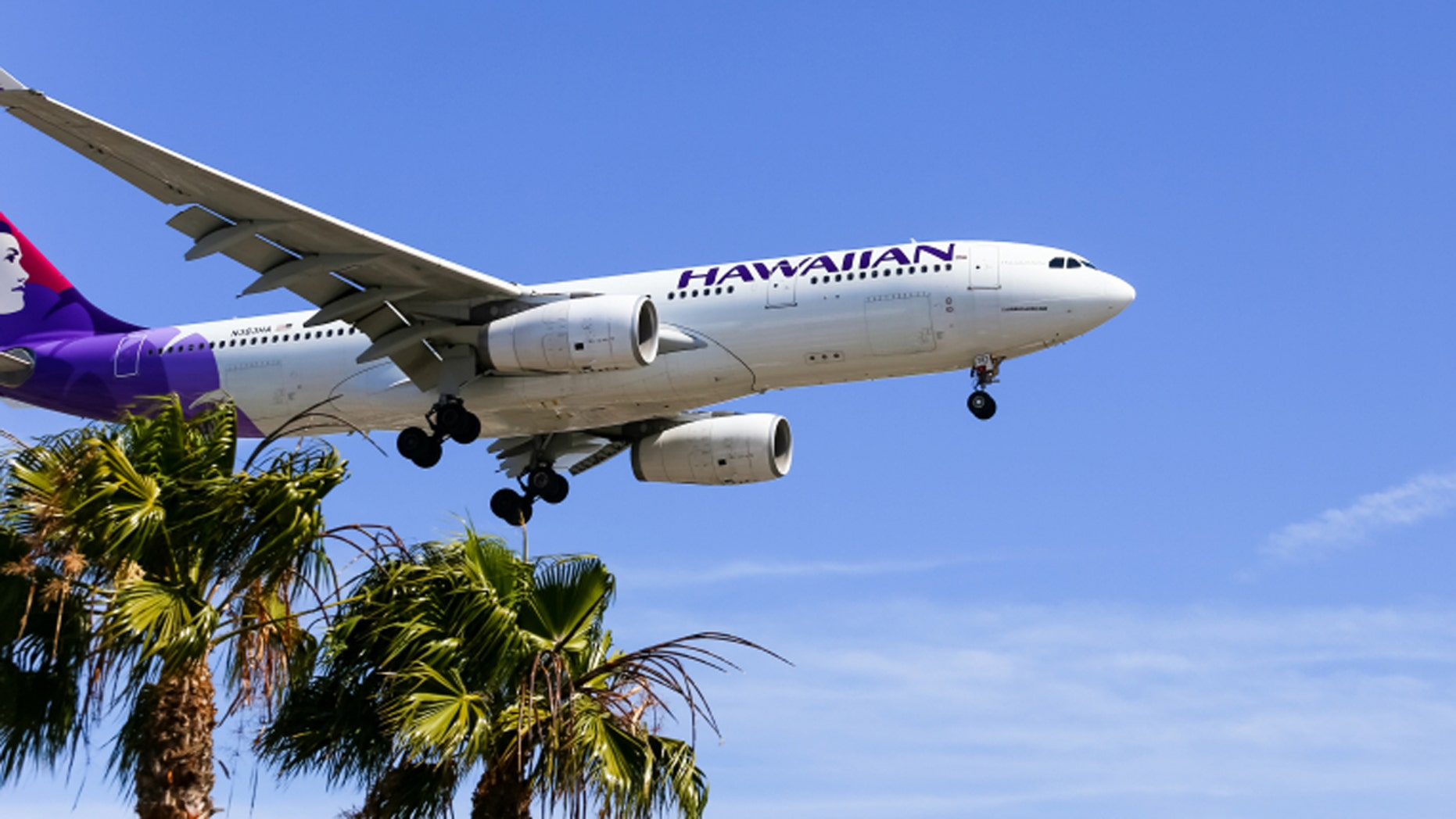 Los Angeles, USA - May 30, 2015: An airplane of Hawaiian Airlines landing at Los Angeles International Airport.