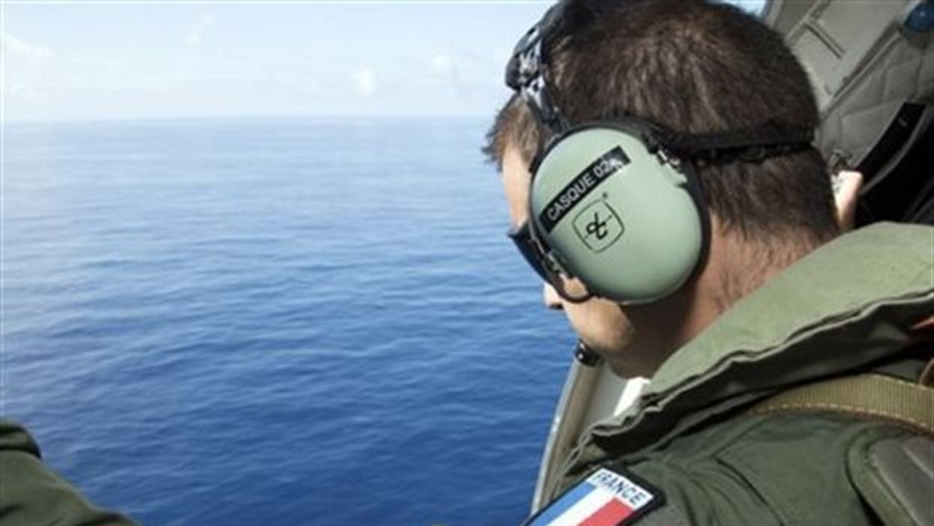 A search team member looking for MH370 wreckage off Reunion Island in August.