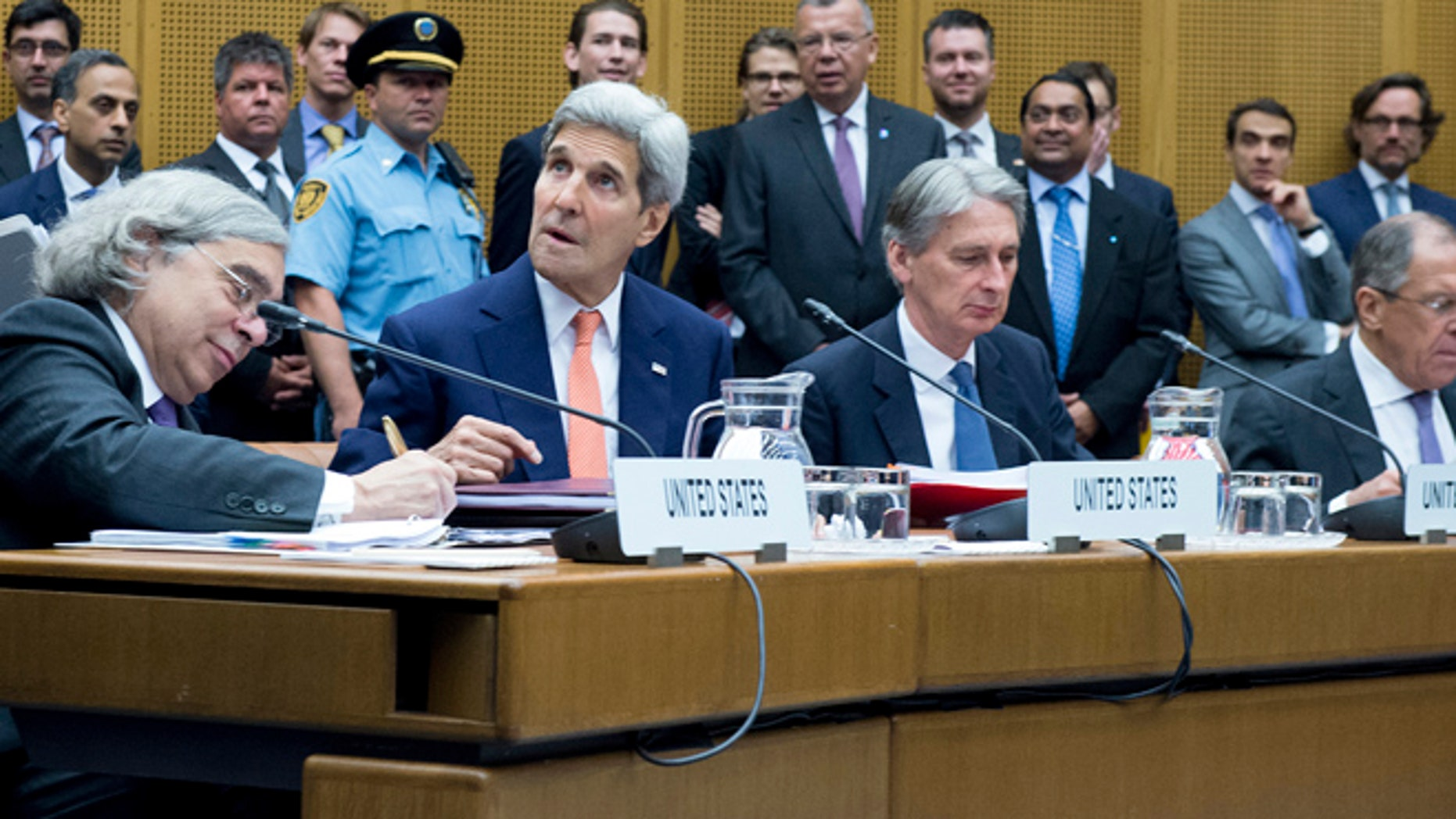 July 14: U.S. Secretary of Energy Ernest Moniz, U.S. Secretary of State John Kerry, British Foreign Secretary Philip Hammond and Russian Foreign Minister Sergey Lavrov (L-R) attend the last plenary session at the United Nations building in Vienna, Austria.