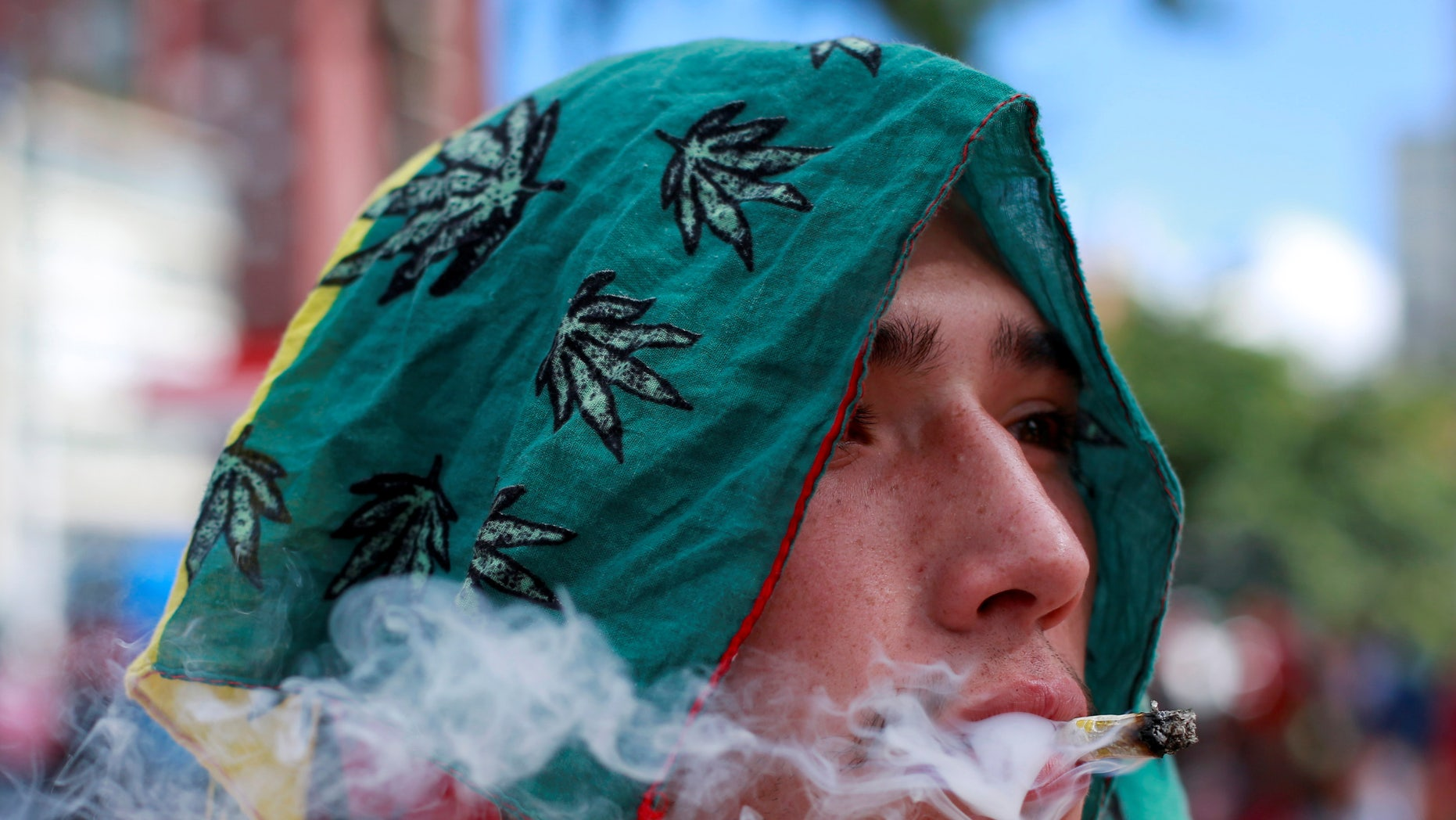 A man smokes marijuana during a global March for marijuana in Bogota, Colombia, May 7, 2016.