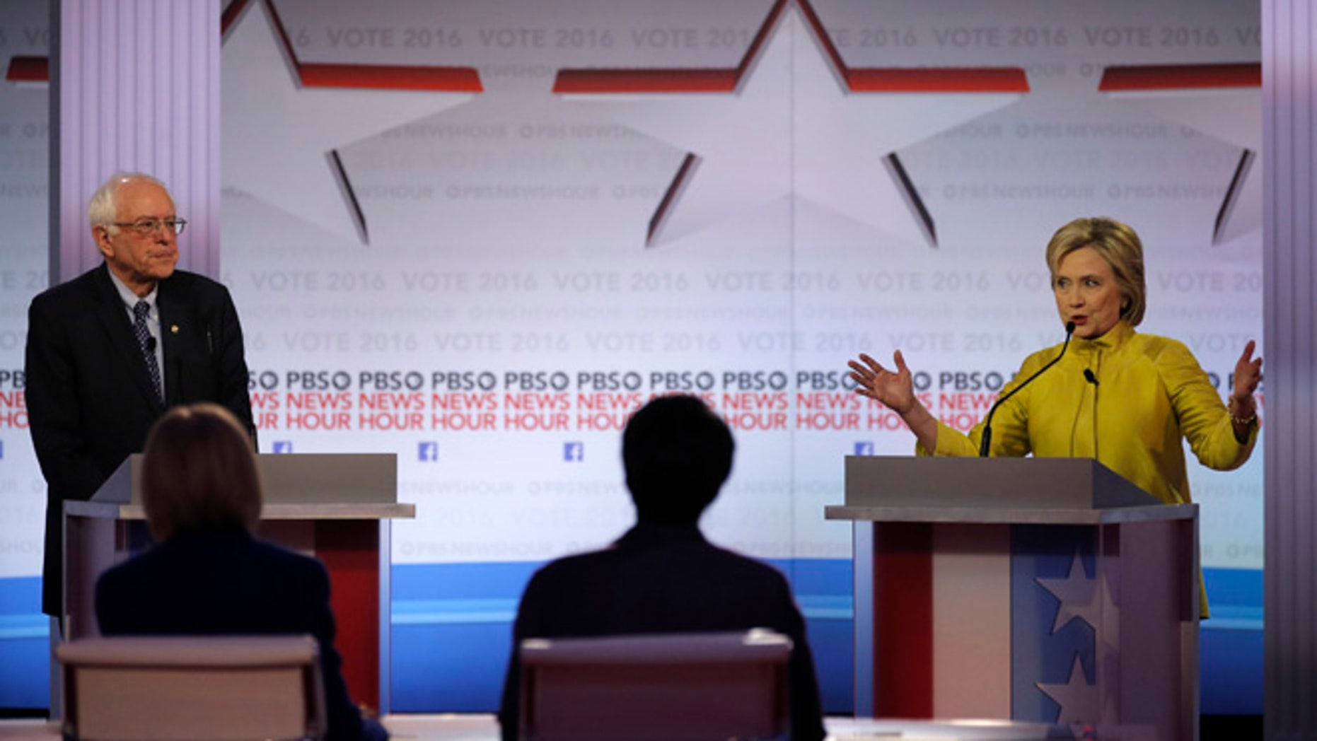 Democratic U.S. presidential candidate former Secretary of State Hillary Clinton speaks as Senator Bernie Sanders listens at the PBS NewsHour Democratic presidential candidates debate in Milwaukee, Wisconsin, February 11, 2016. REUTERS/Jim Young  - RTX26KQQ