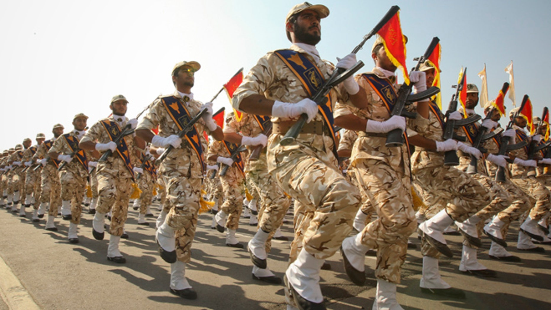 FILE 2011: Members of the Iranian revolutionary guard march during a parade to commemorate the anniversary of the Iran-Iraq war.