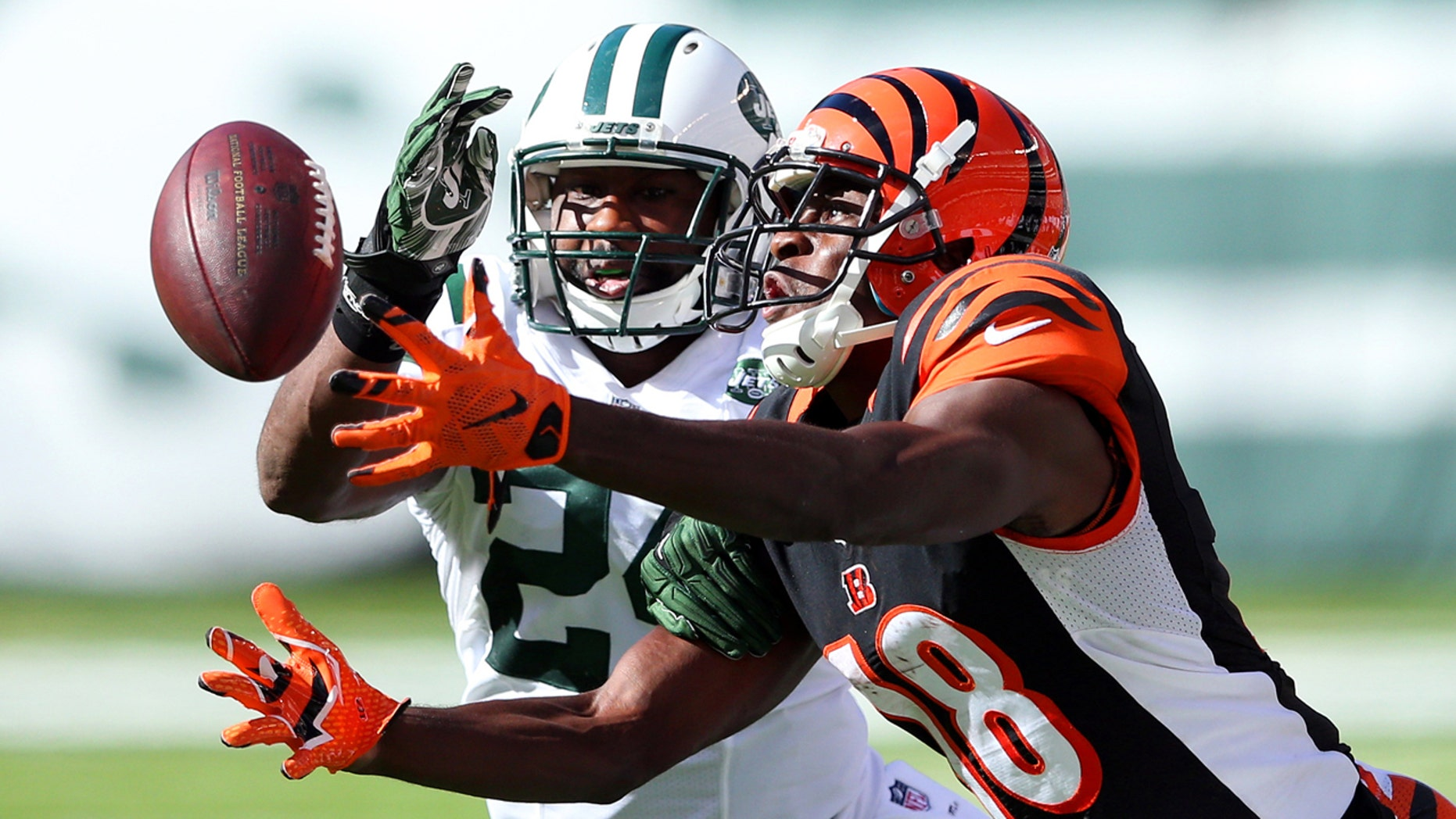 Sep 11, 2016; East Rutherford, NJ, USA; Cincinnati Bengals wide receiver A.J. Green (18) catches a pass in front of New York Jets corner back Darrelle Revis (24) during the fourth quarter at MetLife Stadium. Mandatory Credit: Brad Penner-USA TODAY Sports - RTSN9QC