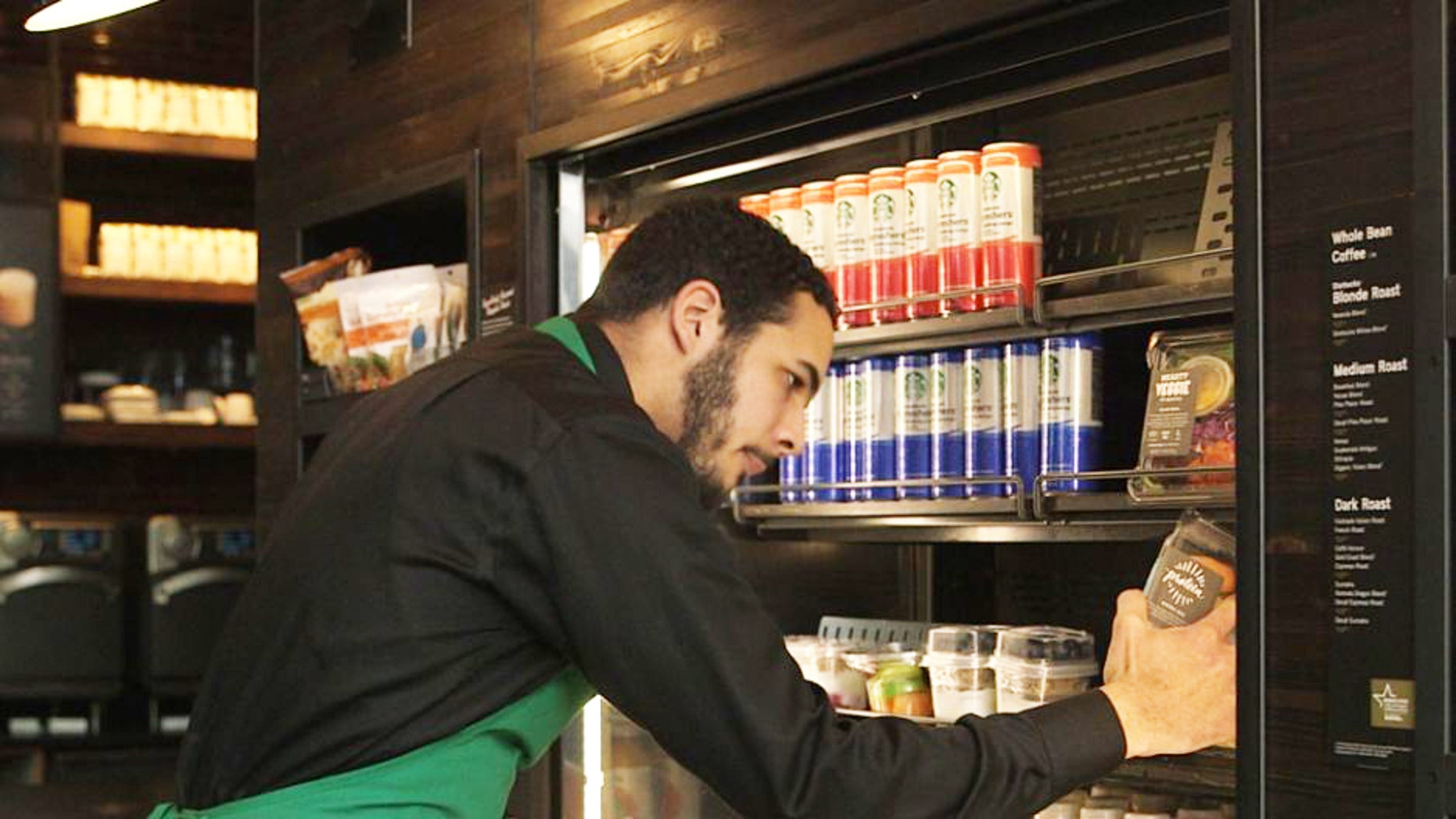 A barista prepares uneaten meals for donation.