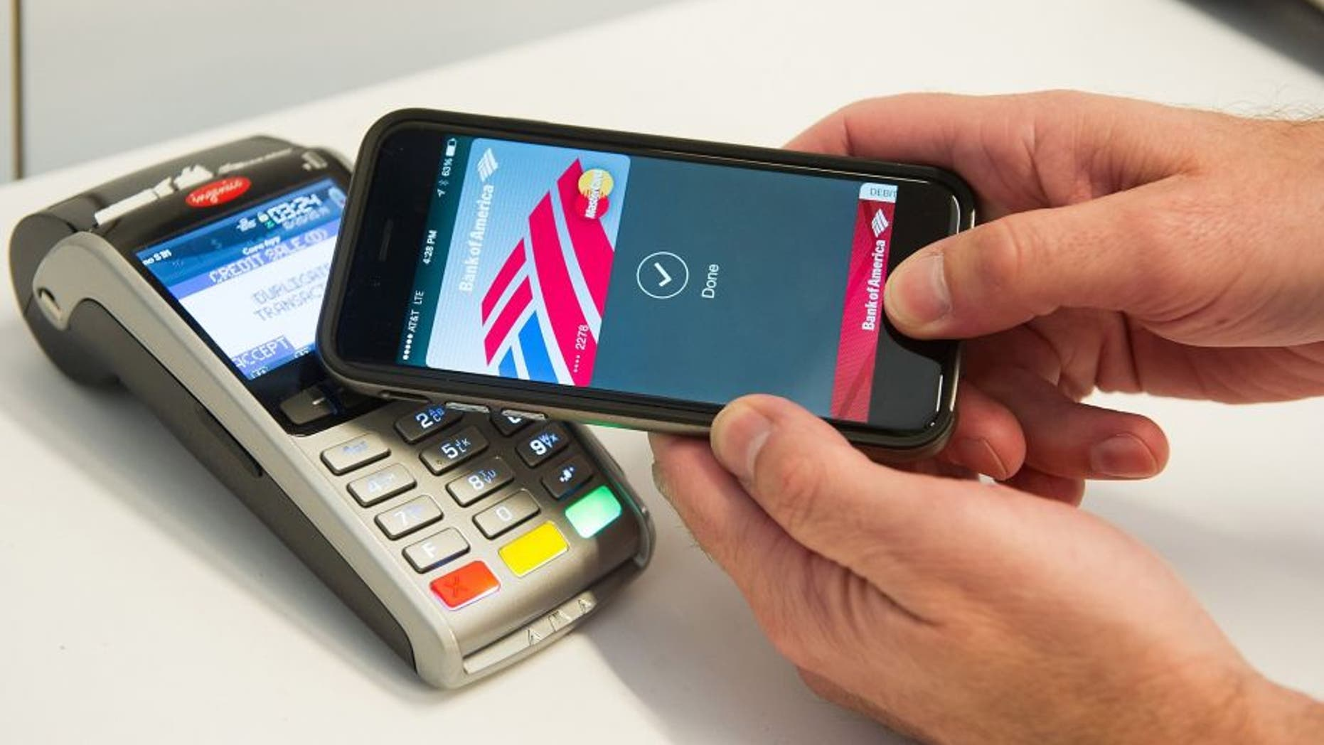 An Apple Pay user demonstrates how to pay via cell phone.