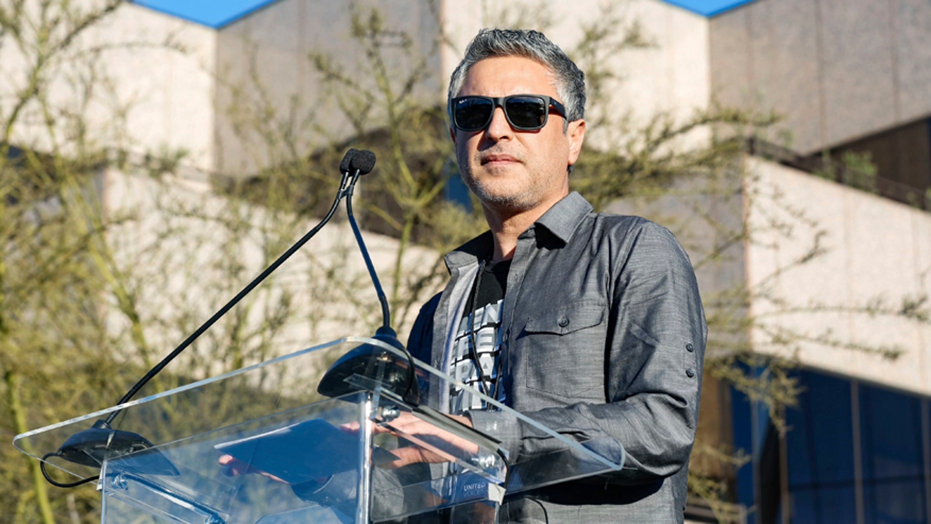 "Reza Aslan speaks at the UTA ""United Voices"" Rally at United Talent Agency headquarters on Friday, Feb. 24, 2017, in Beverly Hills, Calif. He is the host of the new CNN show ""Believer."""