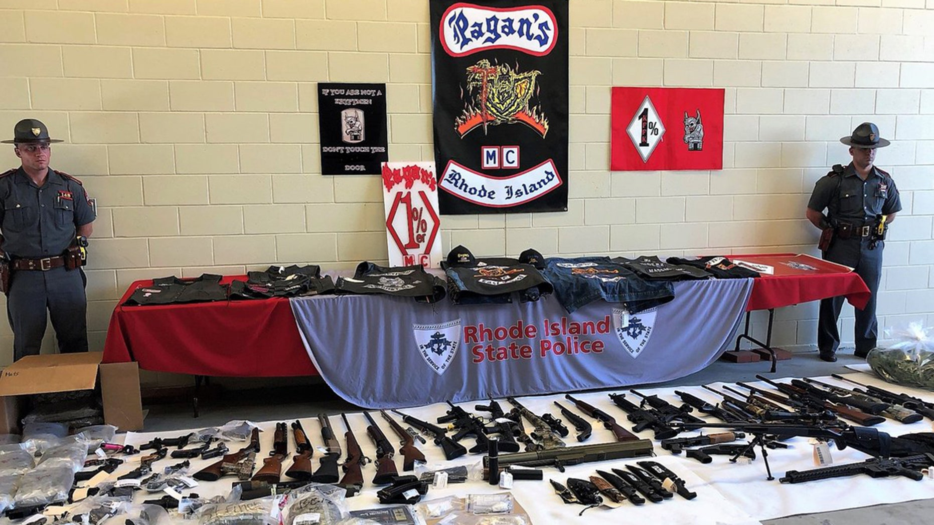 Authorities on Wednesday arrested 50 members of two rival biker gangs in Rhode Island, seizing 53 illegal guns and large quantities of narcotics.