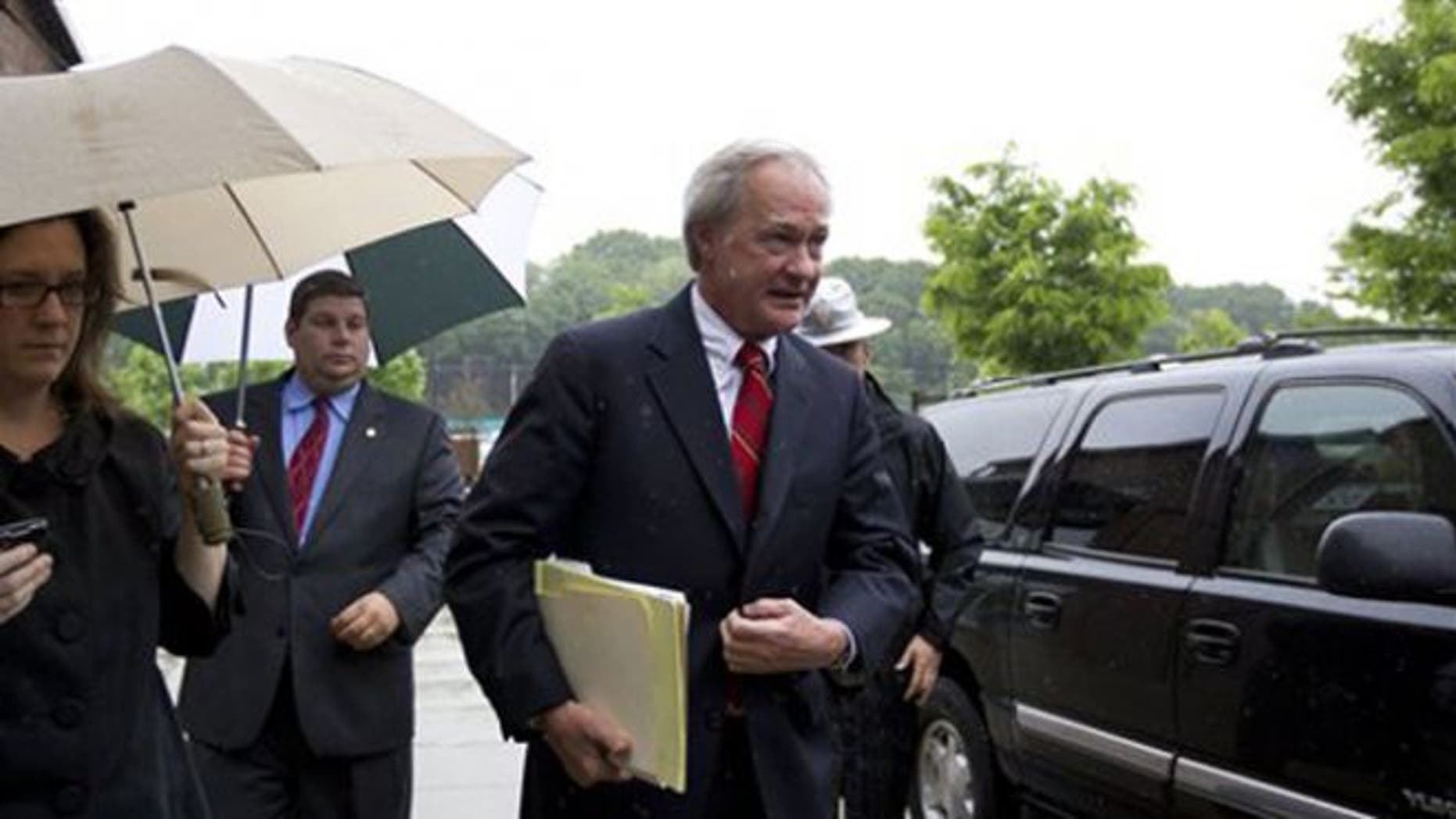 May 21, 2012: Rhode Island Gov. Lincoln Chafee, center, arrives at the state's Economic Development Corp. headquarters in Providence, R.I.