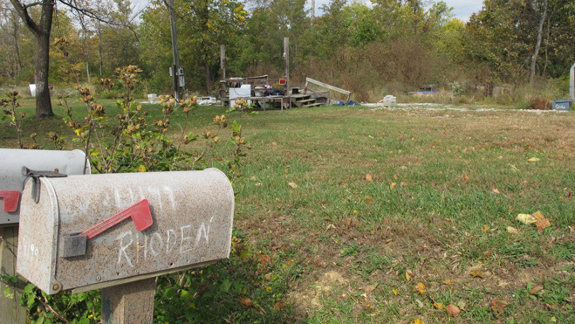 """In this Tuesday, Oct. 18, 2016 photo, a porch is all that remains of the home on Union Hill Road after investigators removed the trailer where the bodies of Clarence """"Frankie"""" Rhoden and Hannah Gilley were found on April 22, two of eight family members found shot to death that day in a still-unsolved crime, in Piketon, Ohio. (AP Photo/Andrew Welsh-Huggins)"""