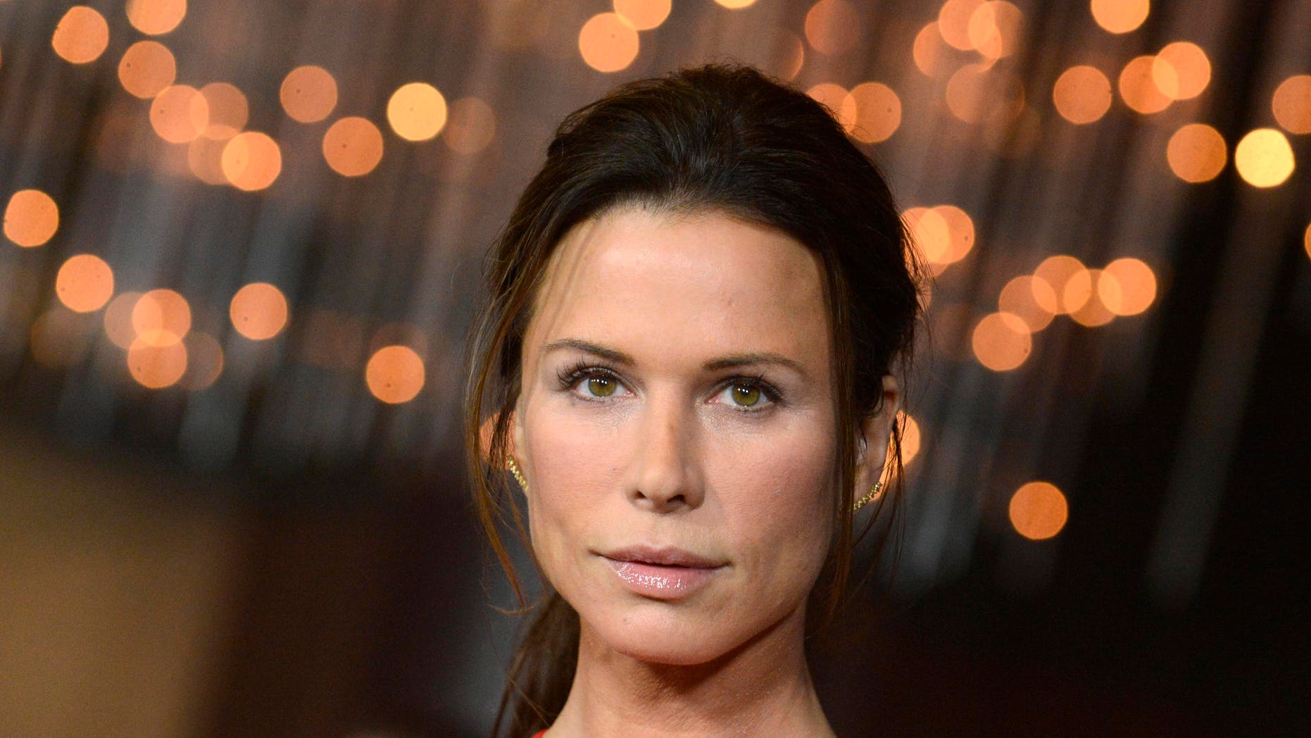 "Cast member Rhona Mitra attends a screening of ""The Loft"" in Los Angeles January 27, 2015. REUTERS/Phil McCarten (UNITED STATES - Tags: ENTERTAINMENT HEADSHOT) - RTR4N8HK"
