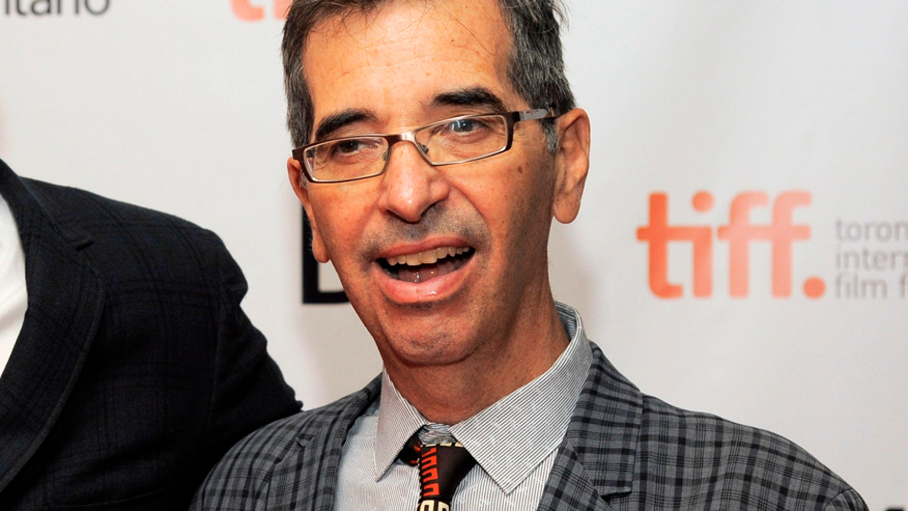 """FILE - In this Sept. 6, 2013 file photo, director Richard Glatzer poses at the premiere of the film """"The Last of Robin Hood"""" at the Toronto International Film Festival at the Isabel Bader Theater in Toronto."""