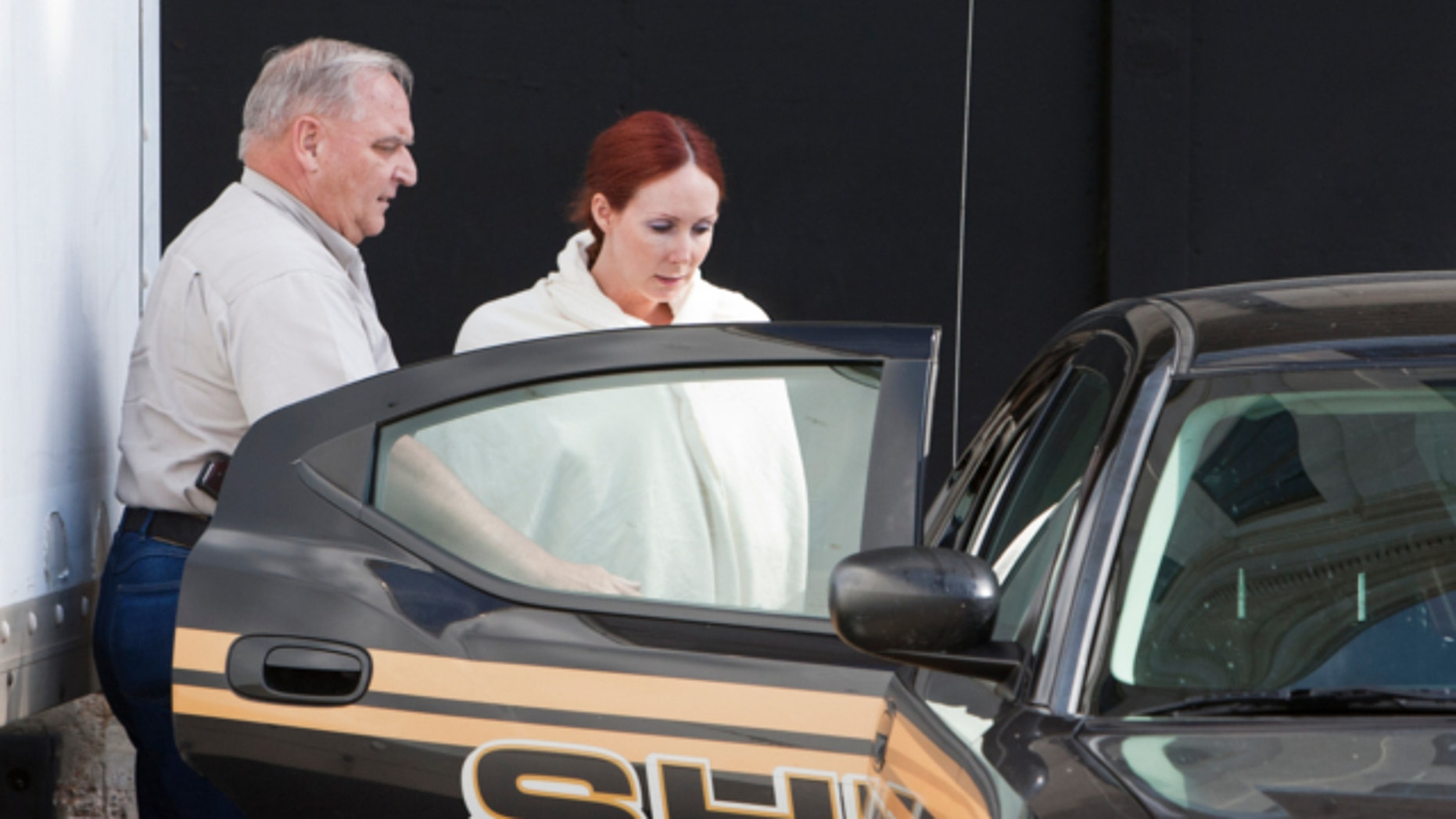 June 7, 2013: Shannon Richardson is placed into a Titus County Sheriff's car after an initial appearance at the federal building Texarkana, Texas.