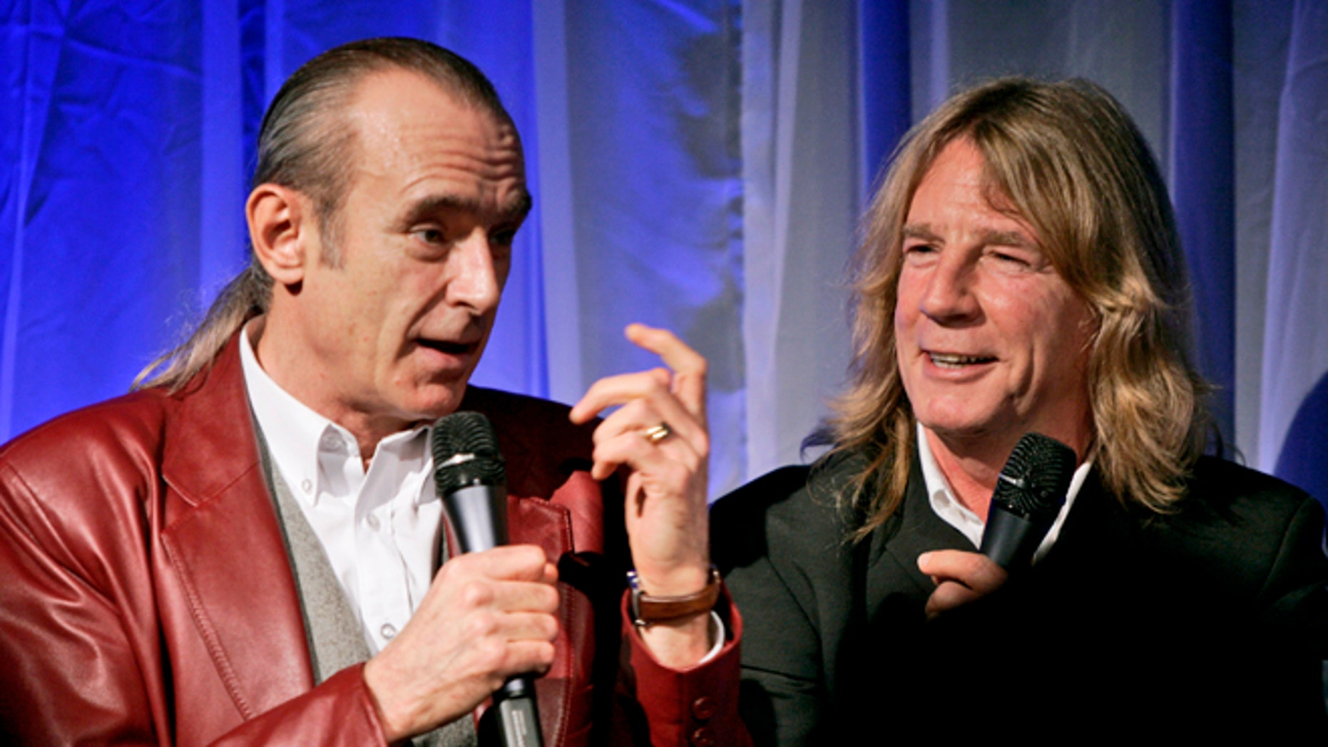 Status Quo members Francis Rossi (left) and Rick Parfitt. Parfitt has died at age 68.