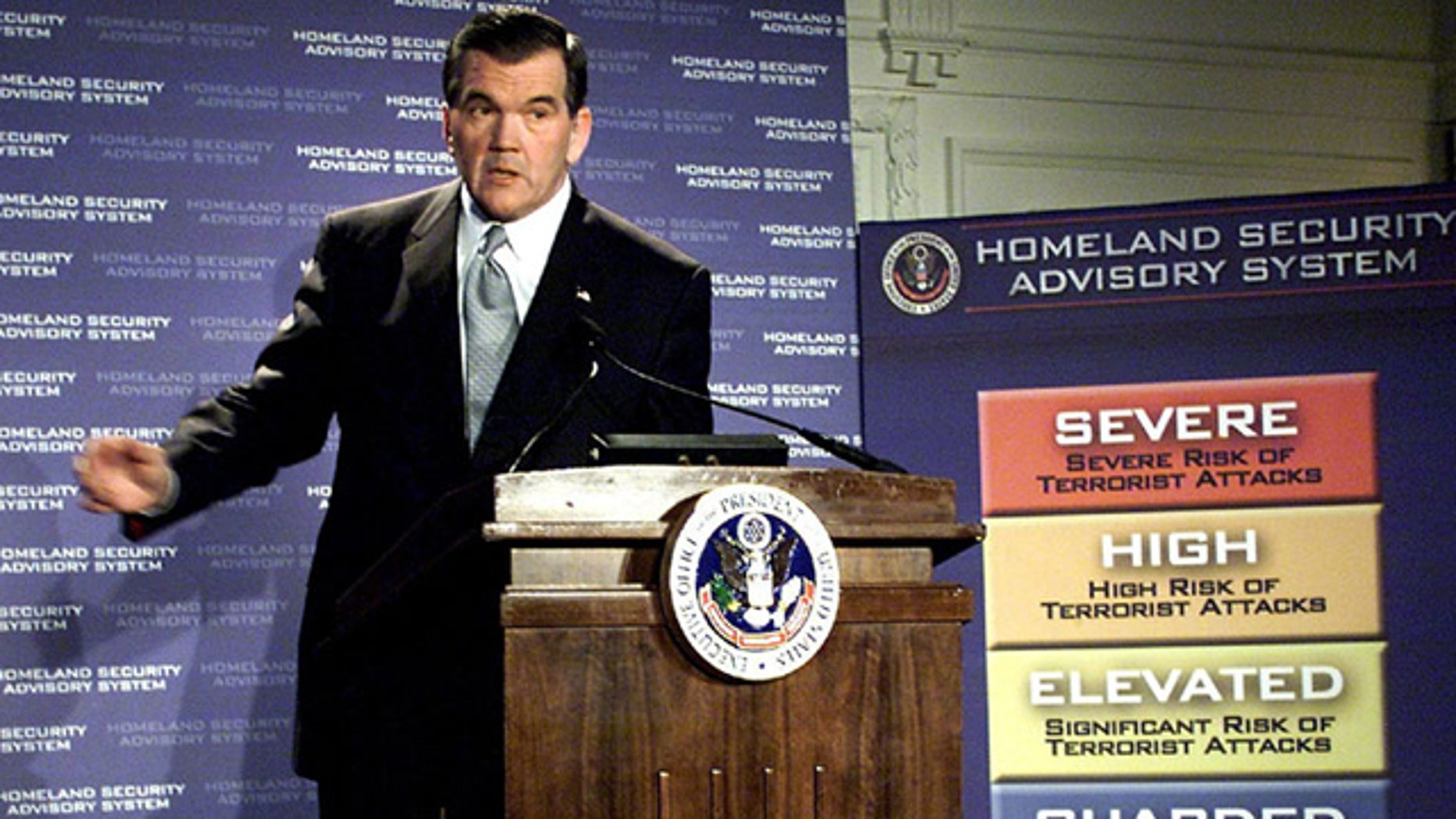 In this March 12, 2002, file photo, then-Homeland Security Director Tom Ridge discusses a color-coded terror alert system in Washington. (AP Photo)