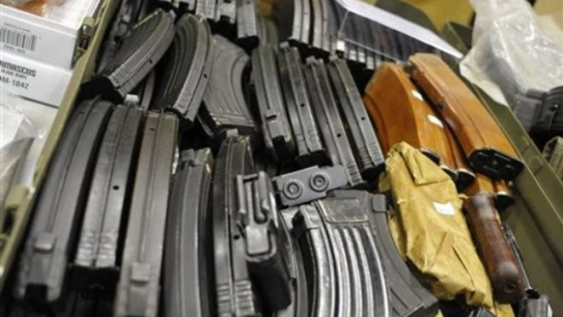 FILE: June 19, 2010: AK-47 assault rifle cartridges fill a box at a gun and knife show in White Plains, N.Y.