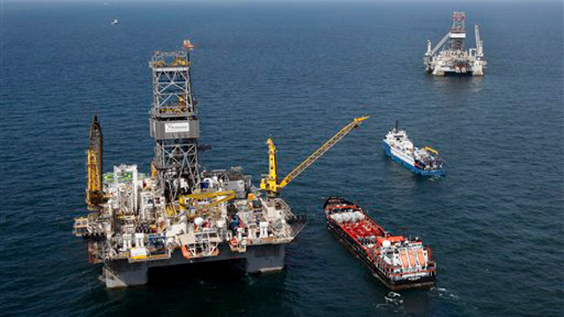 The Transocean Development Driller III, left, and the Transocean Development Driller II, right, the rigs drilling relief wells, are seen on the Gulf of Mexico near the coast of Louisiana Aug. 14. (AP Photo)