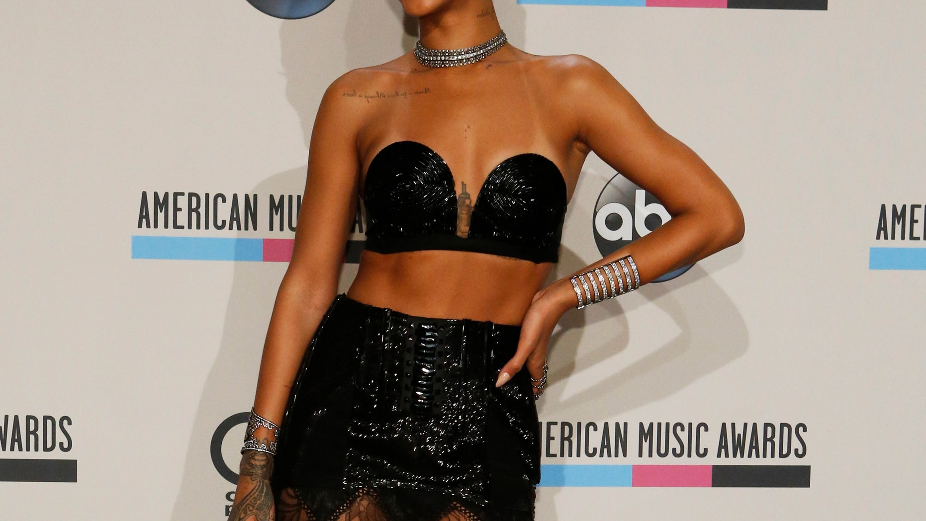 November 24, 2013. Singer Rihanna poses backstage at the 41st American Music Awards in Los Angeles.