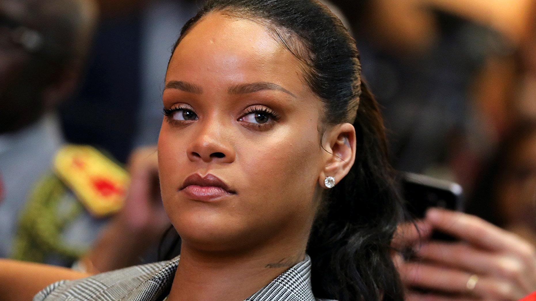 Rihanna's stalker charged following arrest for home break-in.