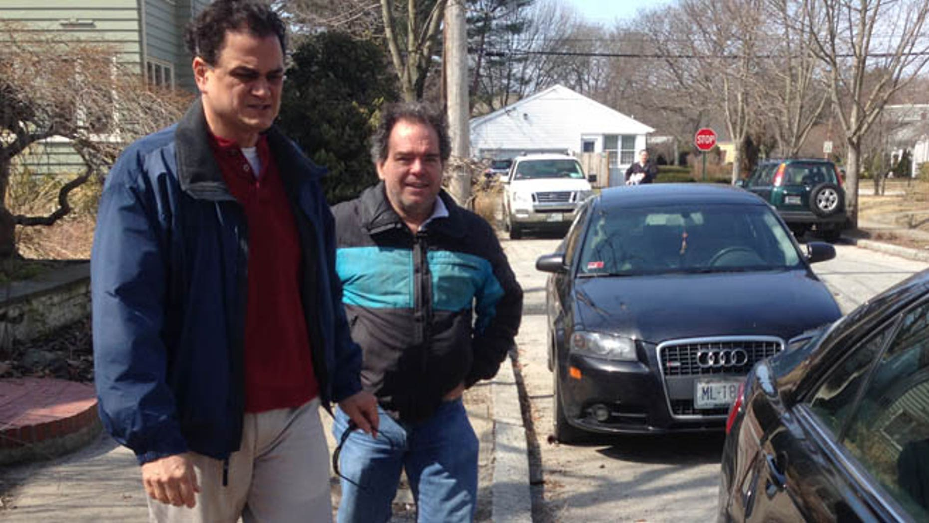 Mar. 22, 2014: Rhode Island House Speaker Gordon Fox speaks to a reporter as he emerges from his home in Providence, R.I..