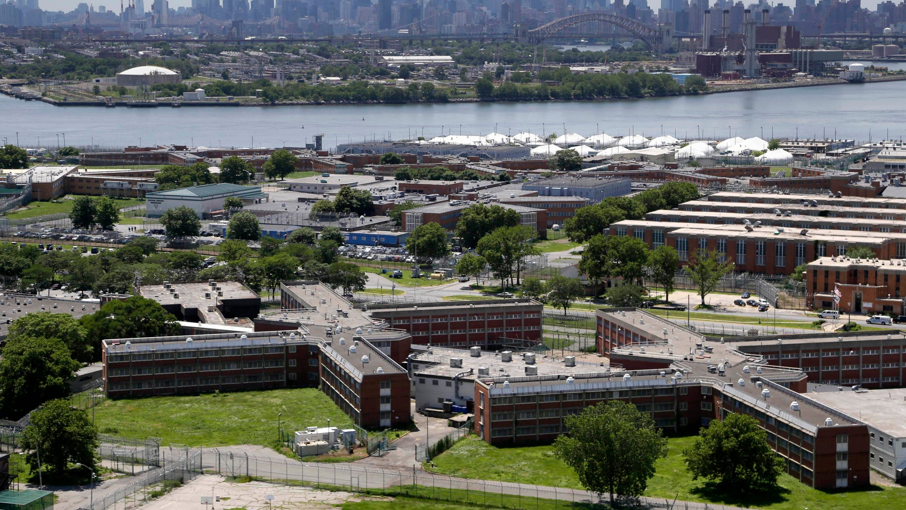 June 20, 2014:  The sprawling Rikers Island jail complex stands in the foreground with the New York skyline in the climbing into the horizon