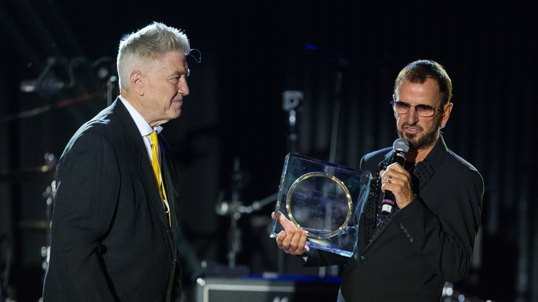 Director David Lynch, left, presents musician Ringo Starr with the Lifetime of Peace & Love Award on stage during the David Lynch Foundation event held at the El Rey Theatre on Monday, Jan. 20, 2014, in Los Angeles.
