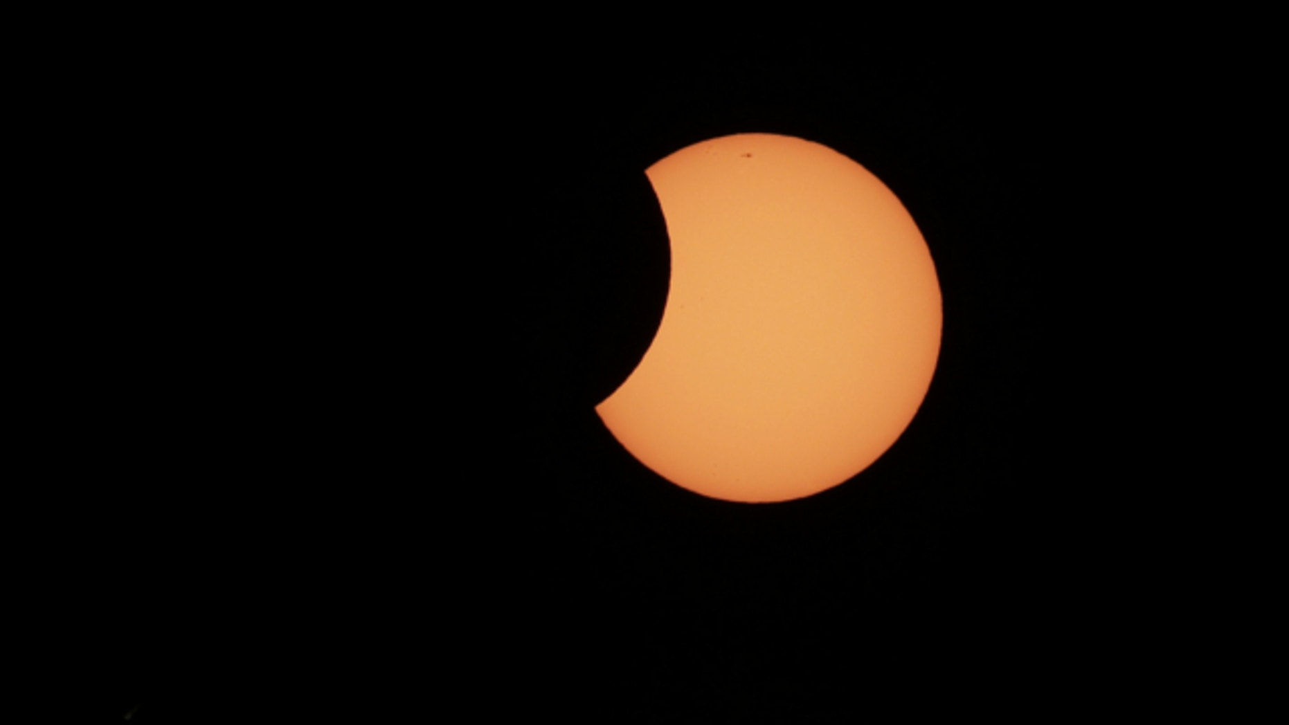 May 10, 2013: The moon begins to cross in front of the sun during a partial solar eclipse in Sydney.