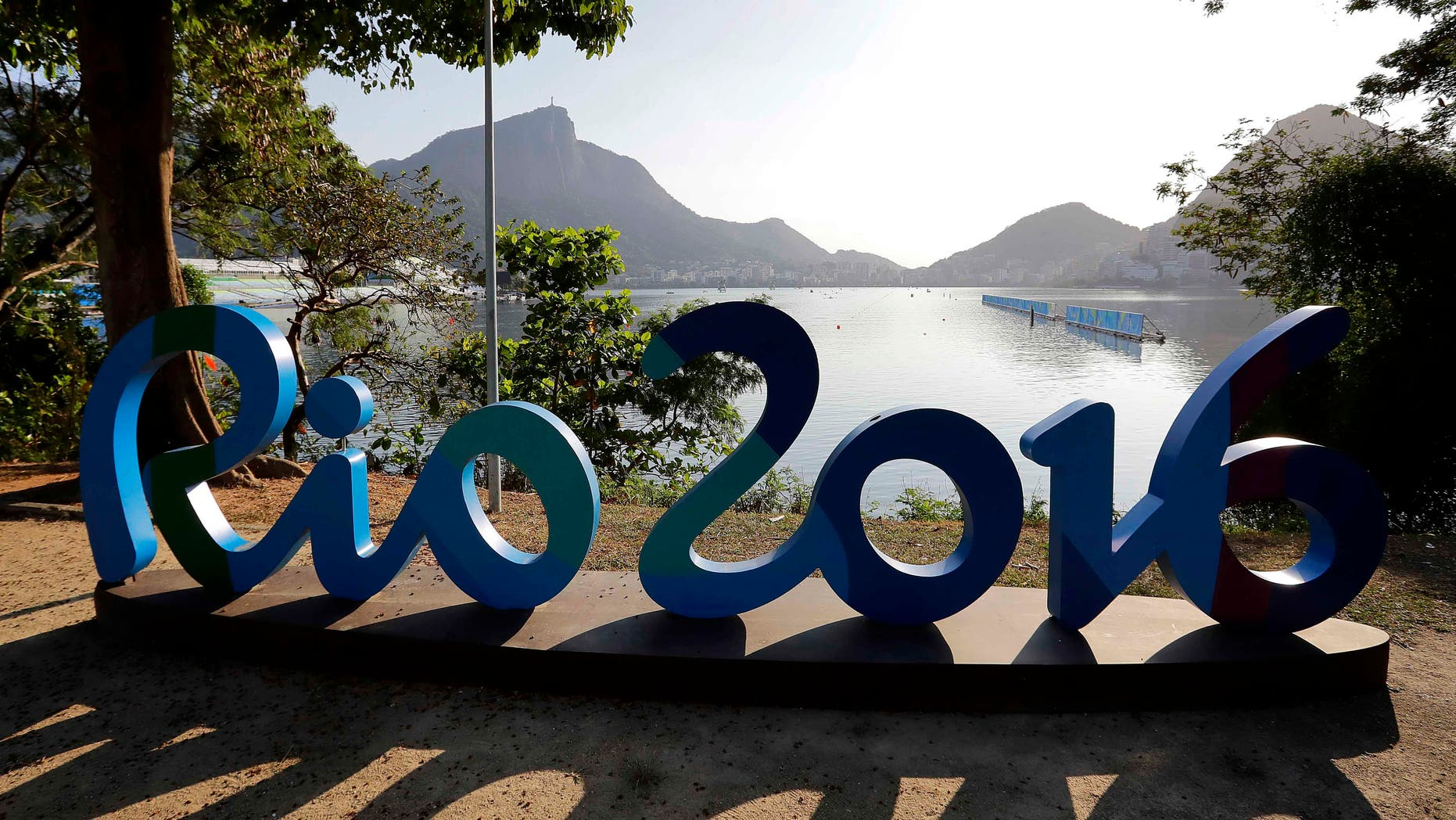 Rowers warm up during rowing team practices in Lagoa ahead of the 2016 Summer Olympics in Rio de Janeiro, Brazil, Friday, Aug. 5, 2016. (AP Photo/Matt York)