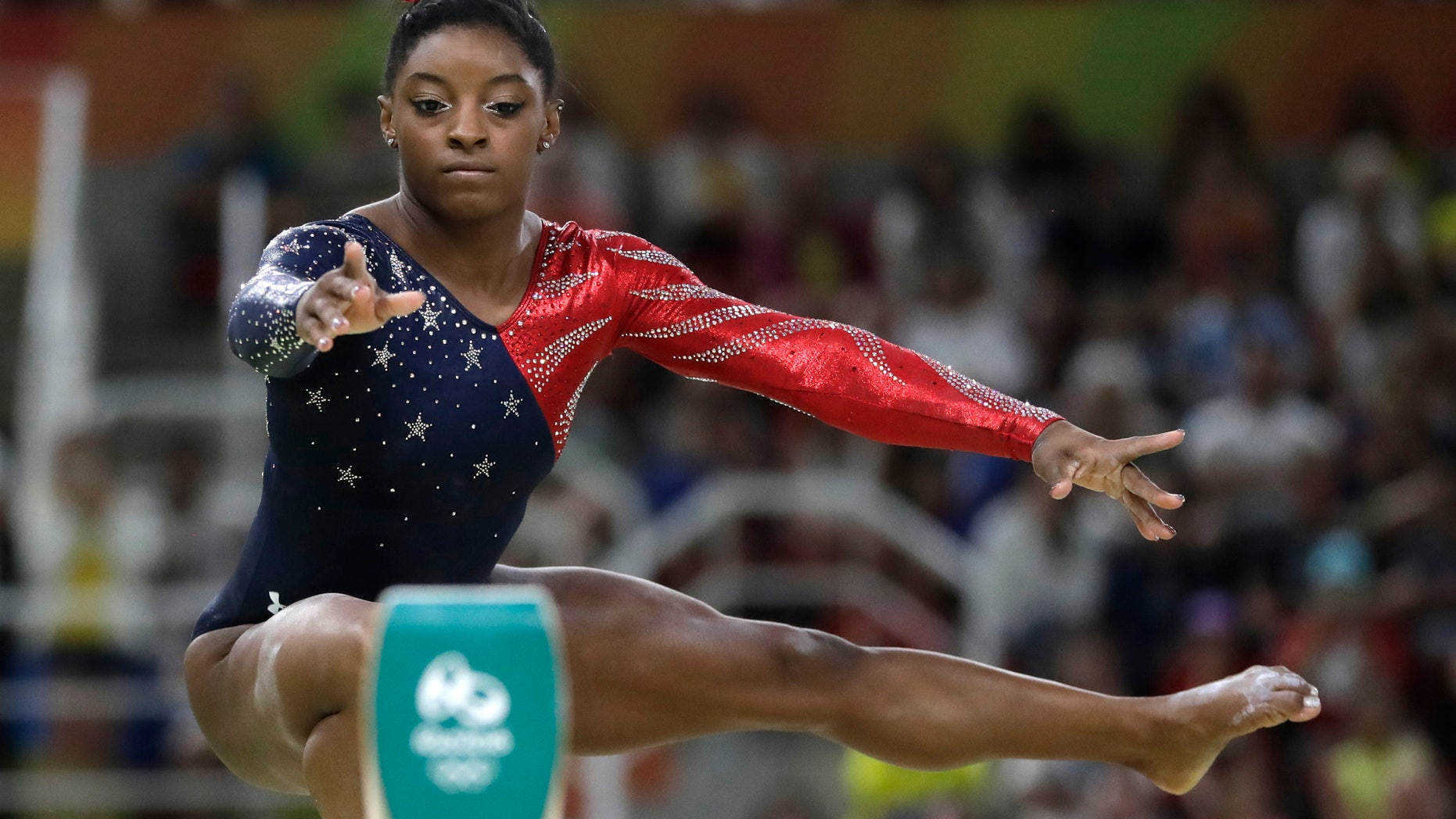 United States' Simone Biles performs on the balance beam during the artistic gymnastics women's qualification at the 2016 Summer Olympics in Rio de Janeiro, Brazil, Sunday, Aug. 7, 2016. (AP Photo/Julio Cortez)