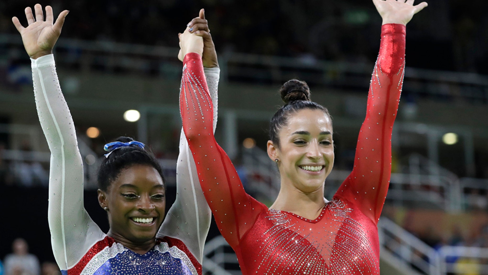 Aug. 11, 2016: United States' Simone Biles, left, and Aly Raisman celebrate after winning gold and silver respectively for the artistic gymnastics women's individual all-around final at the 2016 Summer Olympics in Rio de Janeiro, Brazil.