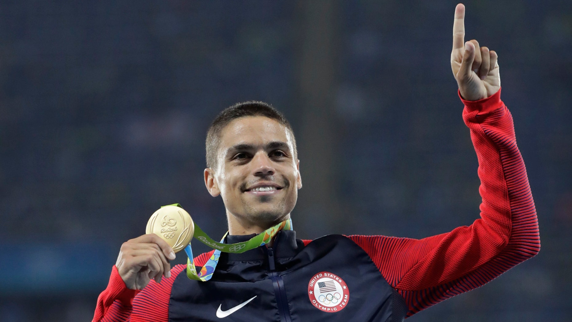 Aug. 20, 2016: United States' Matthew Centrowitz celebrates on the podium after winning the men's 1500-meter final during athletics competitions at the Summer Olympics inside Olympic stadium in Rio de Janeiro, Brazil.