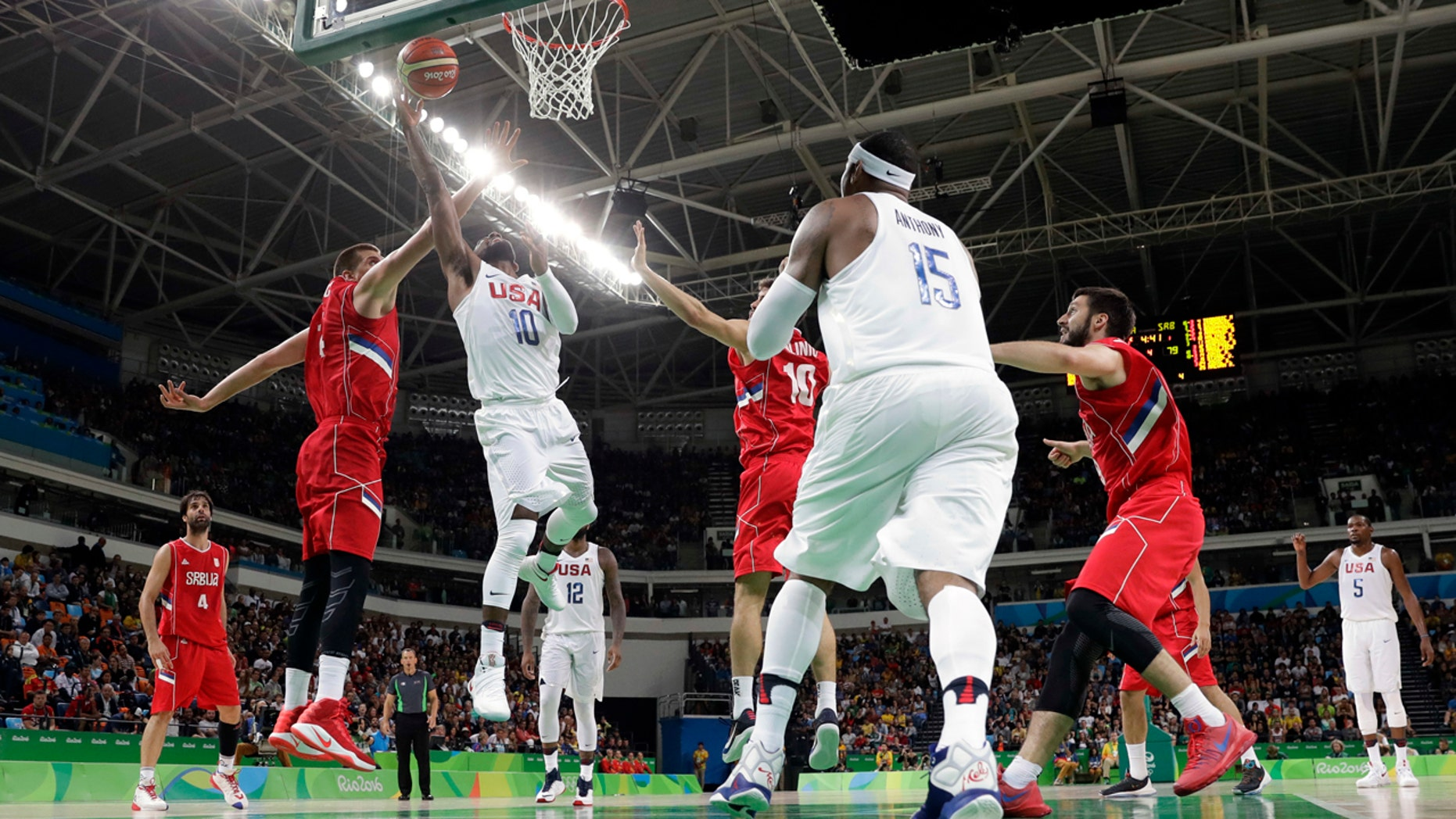 Aug. 12, 2016: United States' Kyrie Irving (10) scores over Serbia's Nikola Jokic, left, during a men's basketball game at the 2016 Summer Olympics in Rio de Janeiro, Brazil.