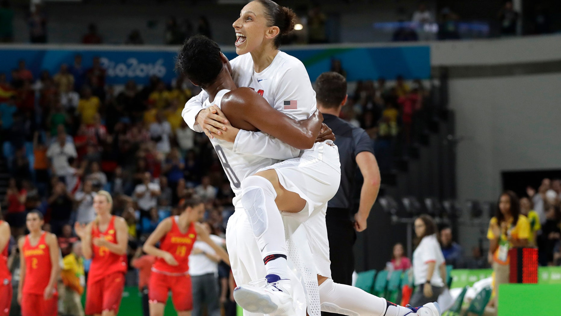 Aug. 20, 2016: United States' Diana Taurasi, right, leaps into the arms of teammate Angel McCoughtry as they celebrate their win over Spain in the women's gold medal basketball game at the 2016 Summer Olympics in Rio de Janeiro, Brazil.