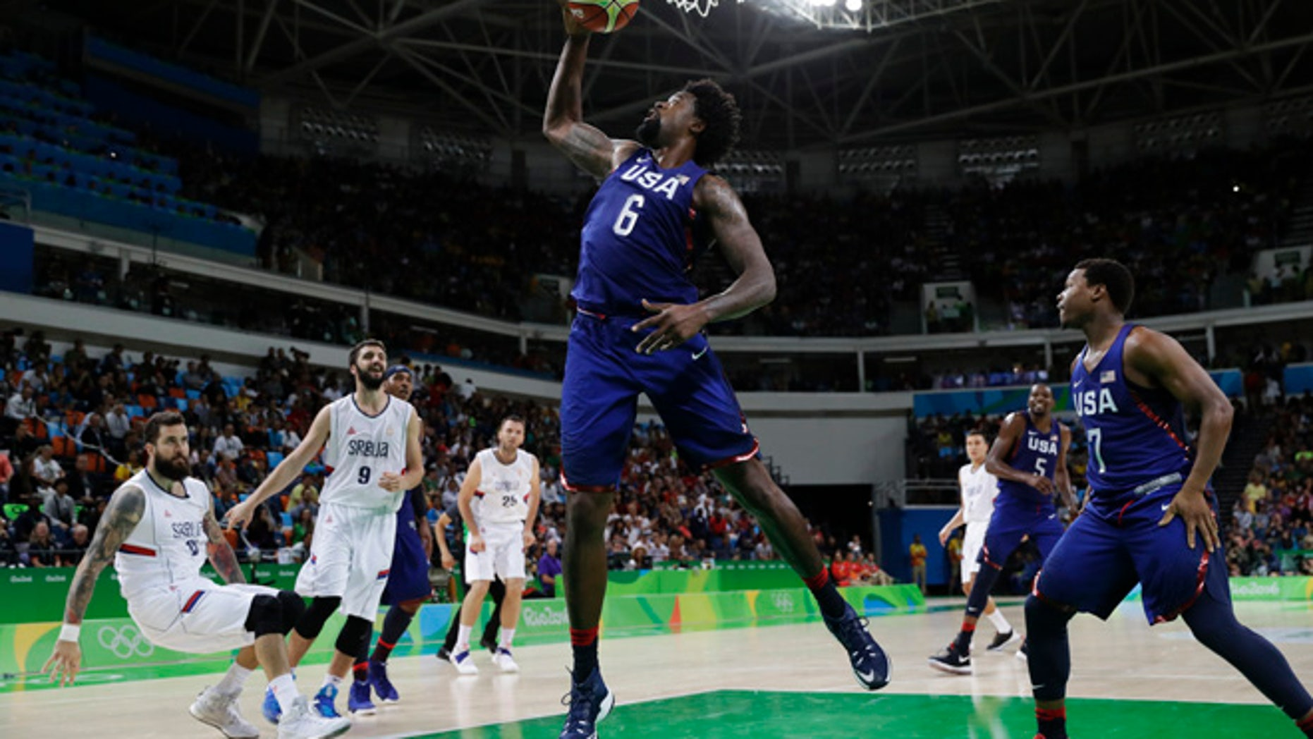 United States' DeAndre Jordan (6) pulls in a rebound against Serbia during the men's gold medal basketball game at the 2016 Summer Olympics in Rio de Janeiro, Brazil, Sunday, Aug. 21, 2016.