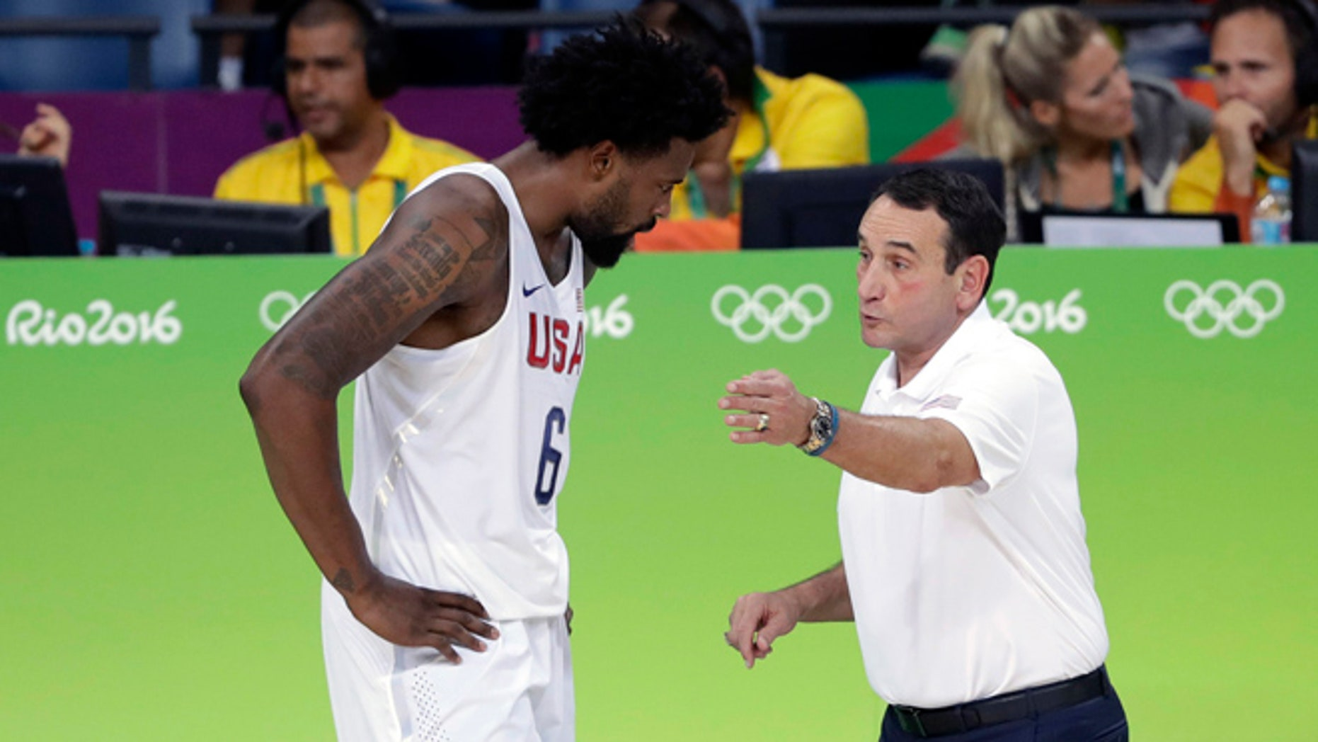 United States basketball coach Mike Krzyzewski, right, talks with DeAndre Jordan (6) during a men's basketball game against France at the 2016 Summer Olympics in Rio de Janeiro, Brazil, Sunday, Aug. 14, 2016.