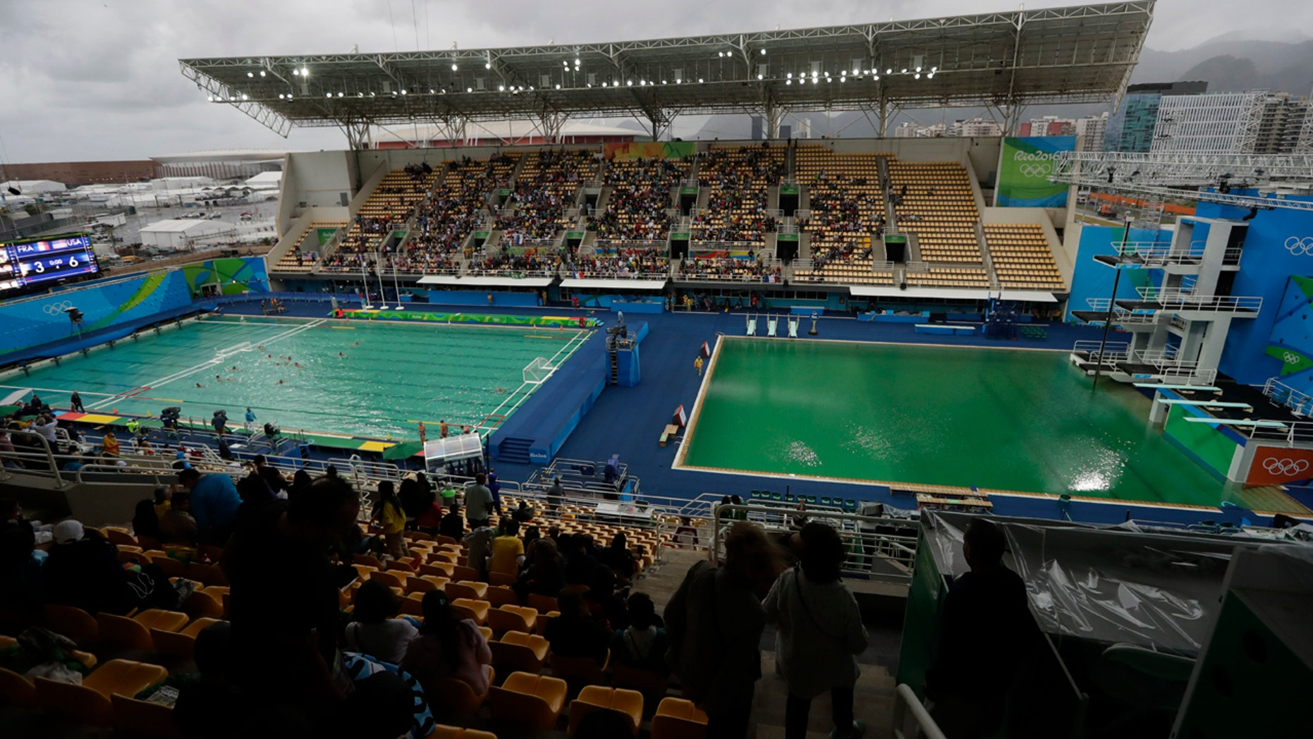 Aug. 10, 2016: The water of the diving pool at right appears a murky green as the water polo pool at left appears a greener color than the previous day during a preliminary round match between United States and France in the Maria Lenk Aquatic Center at the 2016 Summer Olympics in Rio de Janeiro, Brazil.