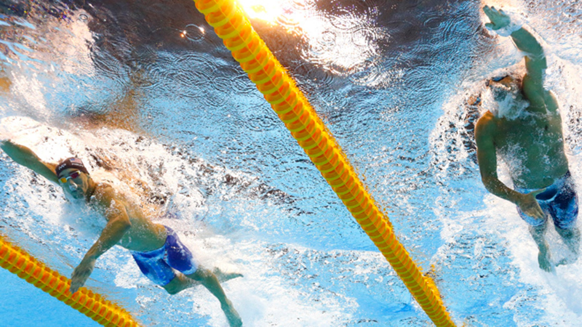 United States' Michael Phelps, left, and Ryan Lochte compete in a semifinal of the men's 200-meter individual medley during the swimming competitions at the 2016 Summer Olympics in Rio de Janeiro, Brazil, Wednesday, Aug. 10, 2016.
