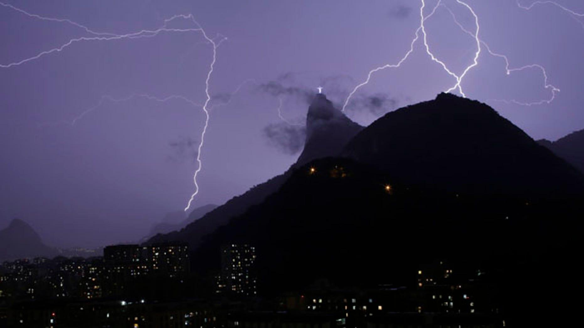 Jan. 16, 2014: Lightning bolts strike through the sky near Christ the Redeemer statue in Rio de Janeiro, Brazil.