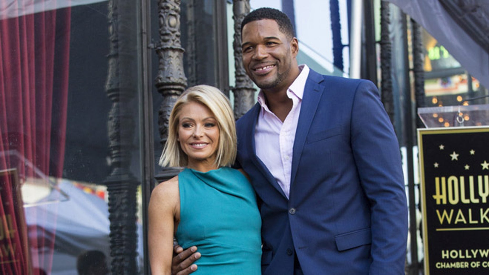 Michael Strahan joins Kelly Ripa as she receives a star on the Hollywood Walk of Fame in 2015.