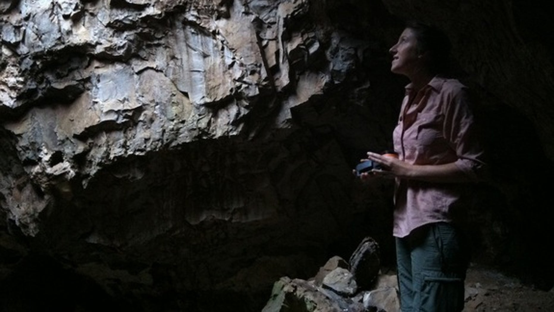 Scientist Hannah Morris admires the skylight in part of the Rising Star Cave in South Africa.