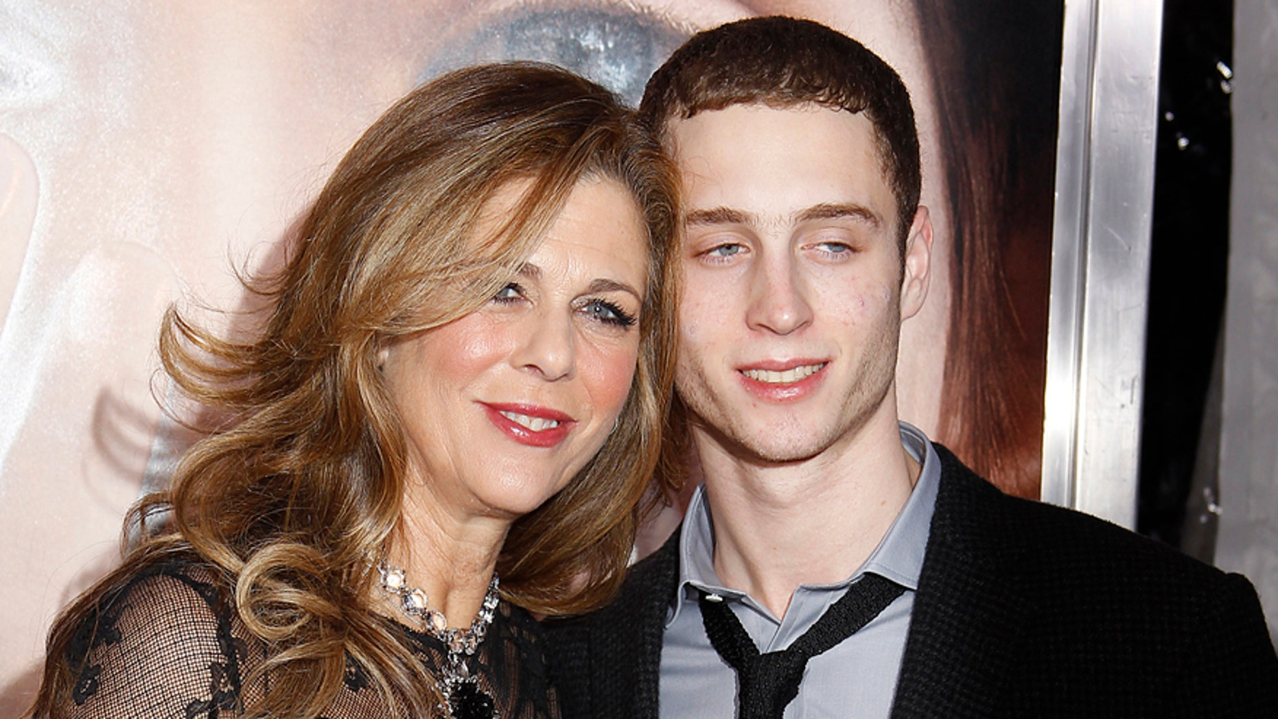 """Actress Rita Wilson and son Chester Hanks (R) arrive for the premiere of the film """"Extremely Loud and Incredibly Close"""" in New York, December 15, 2011.       REUTERS/Carlo Allegri (UNITED STATES - Tags: ENTERTAINMENT) - RTR2VAYE"""