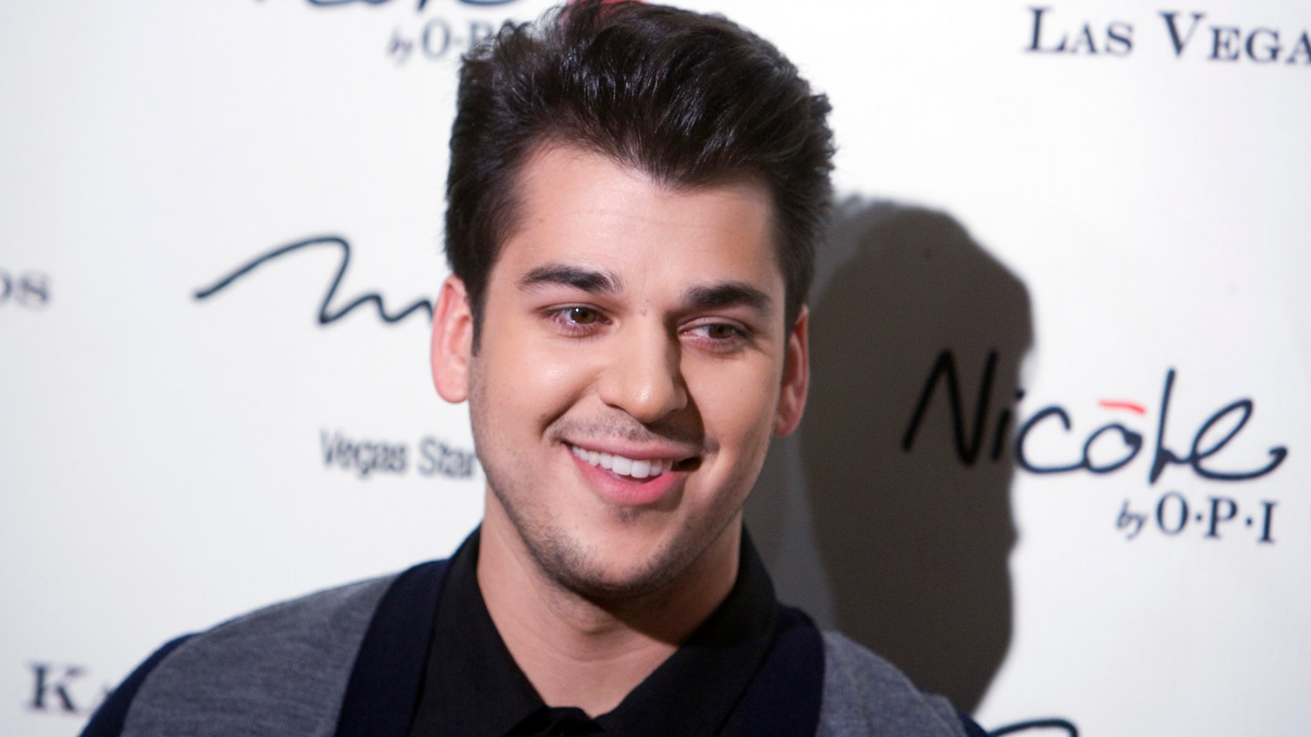 December 15, 2011. Television personality Rob Kardashian arrives at the opening of the Kardashian Khaos store at the Mirage Hotel and Casino in Las Vegas, Nevada.