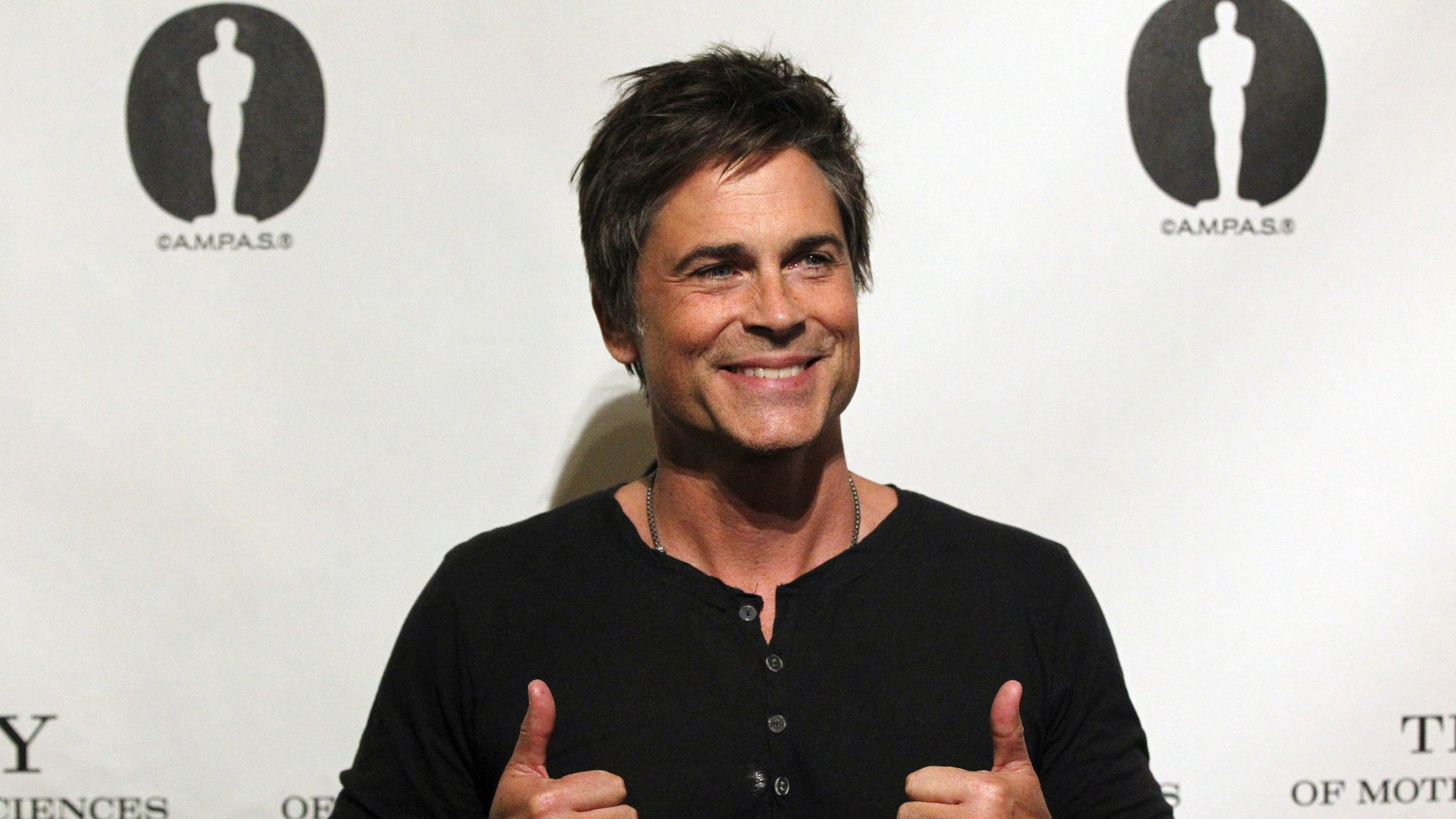"Cast member Rob Lowe poses before a screening and panel discussion for the reunion of the cast of the 1992 movie ""Wayne's World"" at the Academy of Motion Picture Arts and Sciences in Beverly Hills, California April 23, 2013. REUTERS/Mario Anzuoni (UNITED STATES - Tags: ENTERTAINMENT) - RTXYXOG"